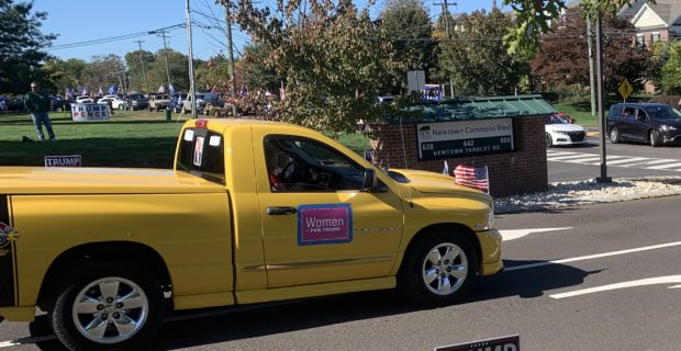 A vehicle with 'Women For Trump' sign follows the parade route in Newtown, Pennsylvania, on Oct. 17, 2020. (Bernadette Breslin / Daily Caller News Foundation)