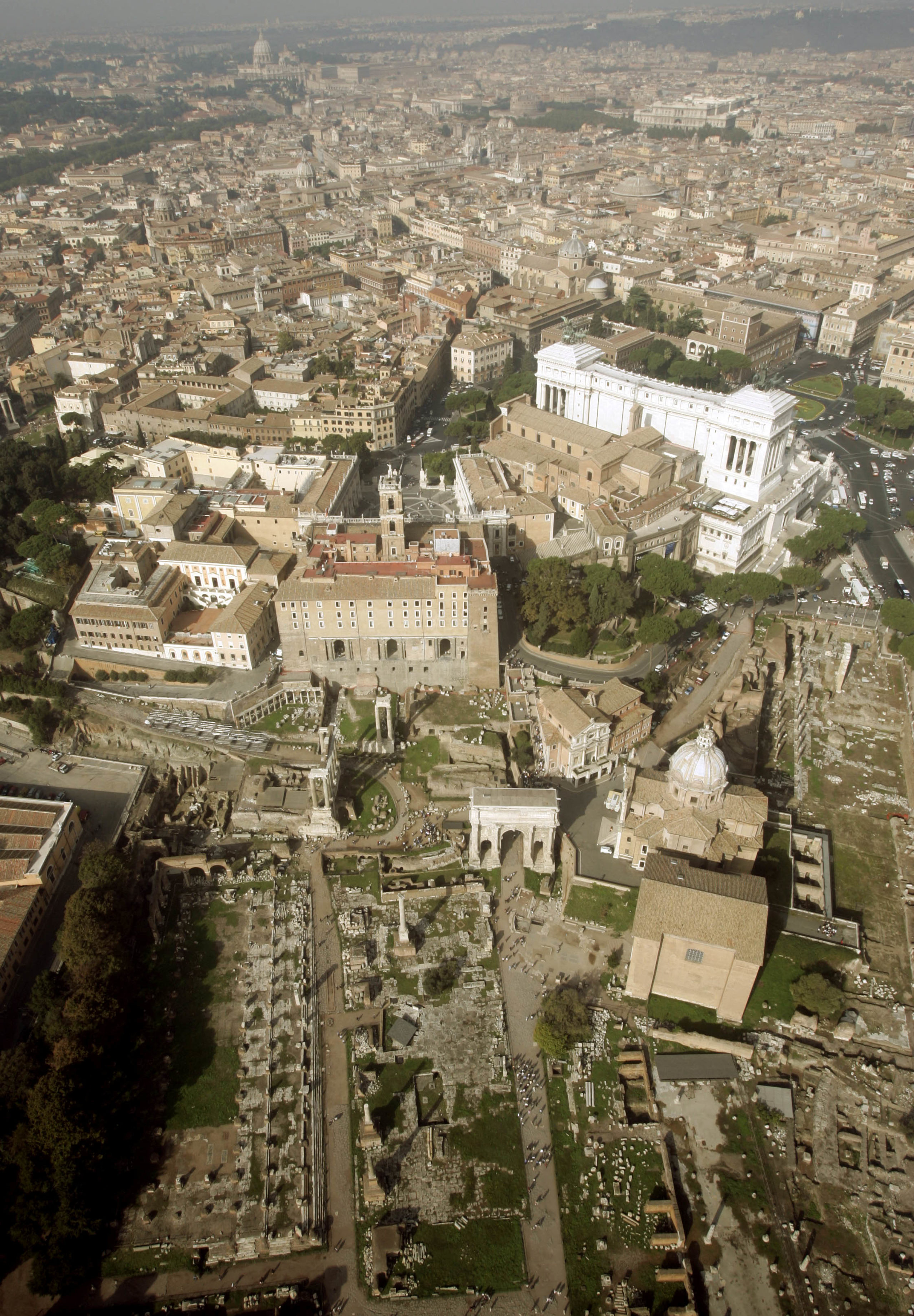Rome's ancient Forum lies in the centre of the Italian capital in an aerial file photo October 24, 2004. In a discovery that may force the rewriting of Ancient Roman history, Italian archaeologists digging in the Forum have unearthed the ruins of a palace they say confirms the legend of Rome's birth. NO RIGHTS CLEARANCES OR PERMISSIONS ARE REQUIRED FOR THIS IMAGE. REUTERS/Alessandro Bianchi AB/MA