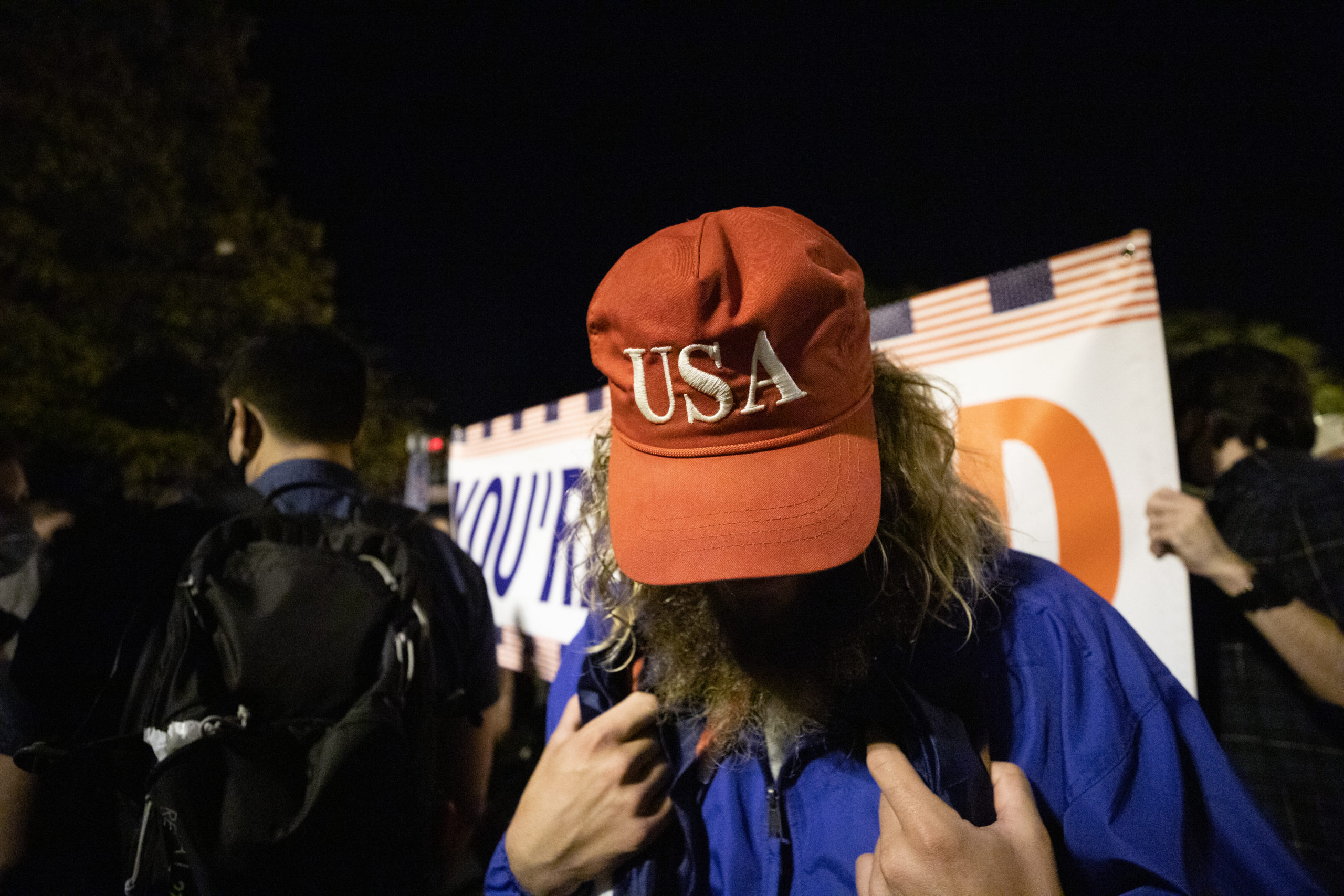 At least one maskless Trump supporter attended the celebration at Balck Lives Matter Plaza, though he would not speak on the record or have photographs taken if his face was visible, in Washington, D.C. on Nov. 7, 2020. (Kaylee Greenlee - Daily Caller News Foundation)