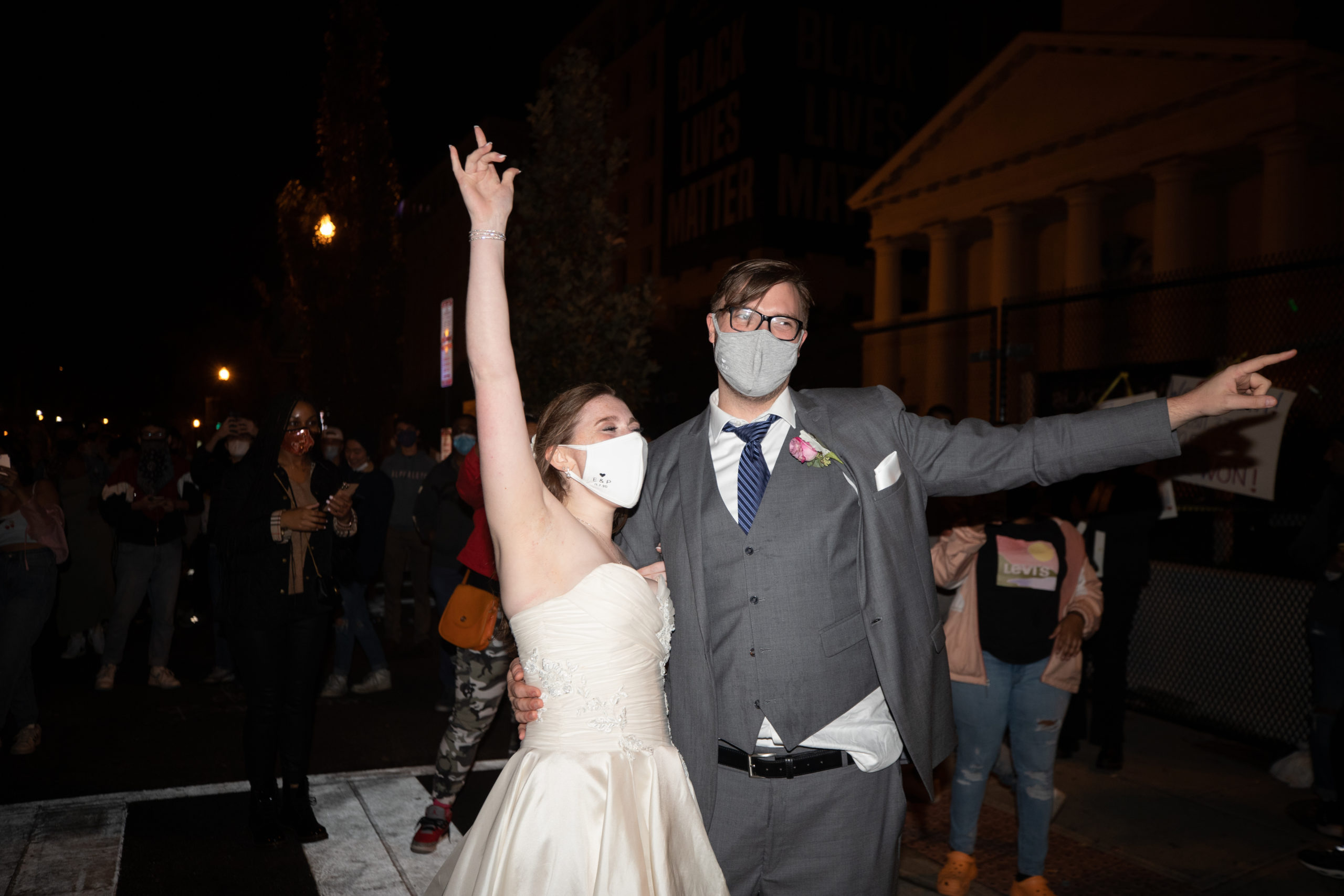 A newlywed couple showed up at Black Lives Matter Plaza early Sunday morning to celebrate the predicted election of Democratic nominee Joe Biden and Kamala Harris, in Washington D.C. on Nov. 8, 2020. (Kaylee Greenlee - Daily Caller News Foundation)