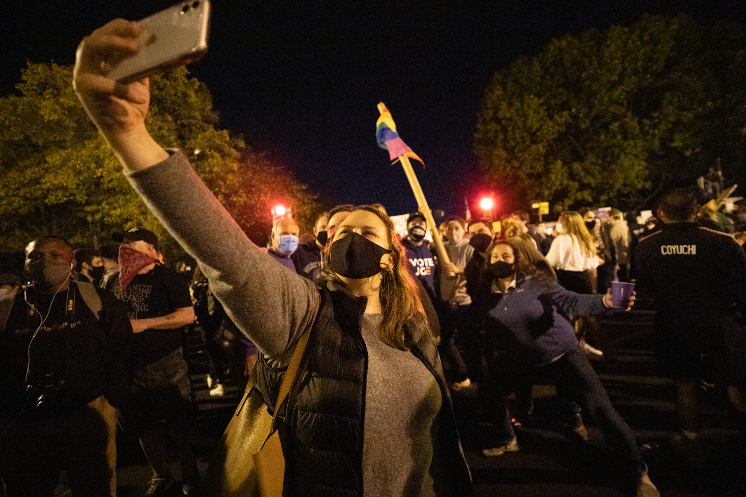 Several people gathered at Black Lives Matter Plaza on Saturday night to celebrate the predicted election of Democratic nominee Joe Biden and Kamala Harris, in Washington D.C. on Nov. 7, 2020. (Kaylee Greenlee - Daily Caller News Foundation)