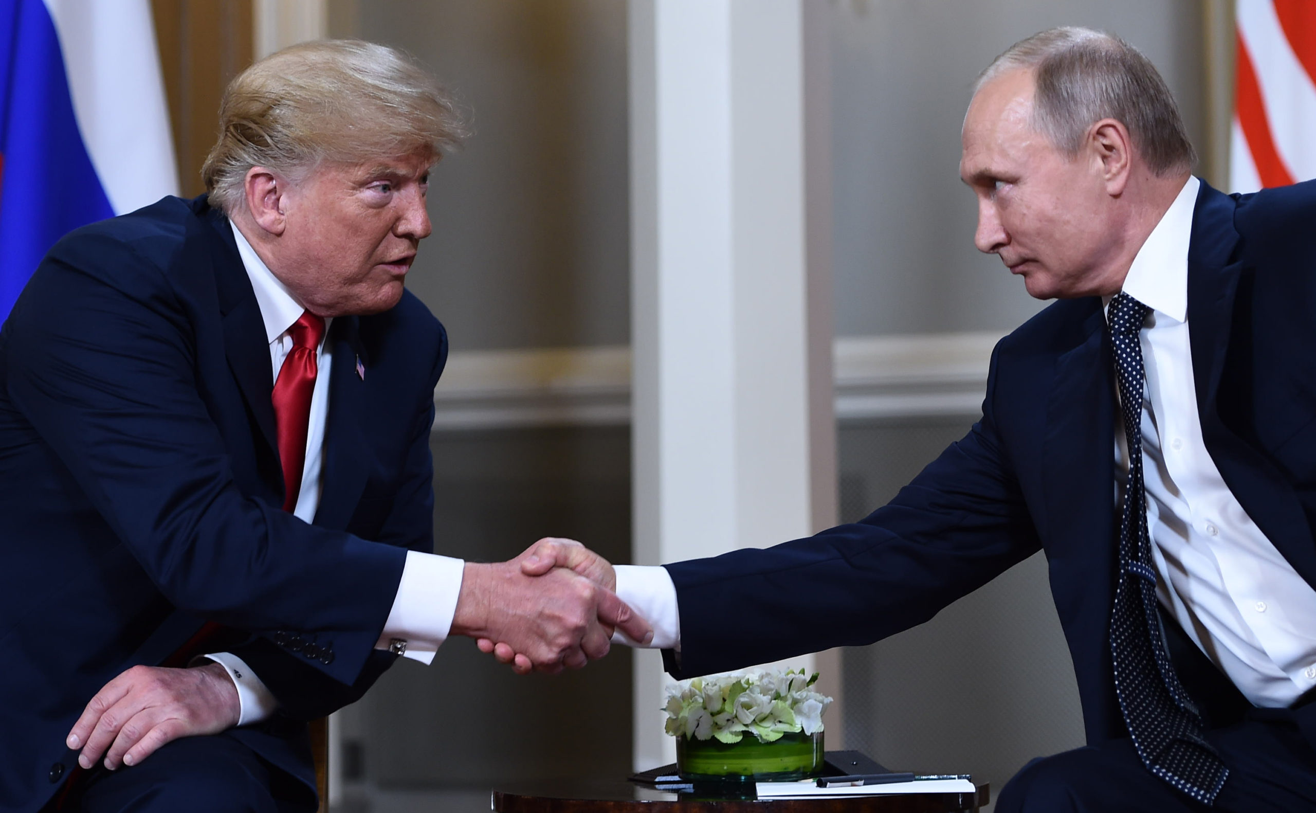 President Donald Trump and Russia President Vladimir Putin shake hands before a meeting in Helsinki, Finland on July 16, 2018. (Brendan Smialowski/AFP via Getty Images)