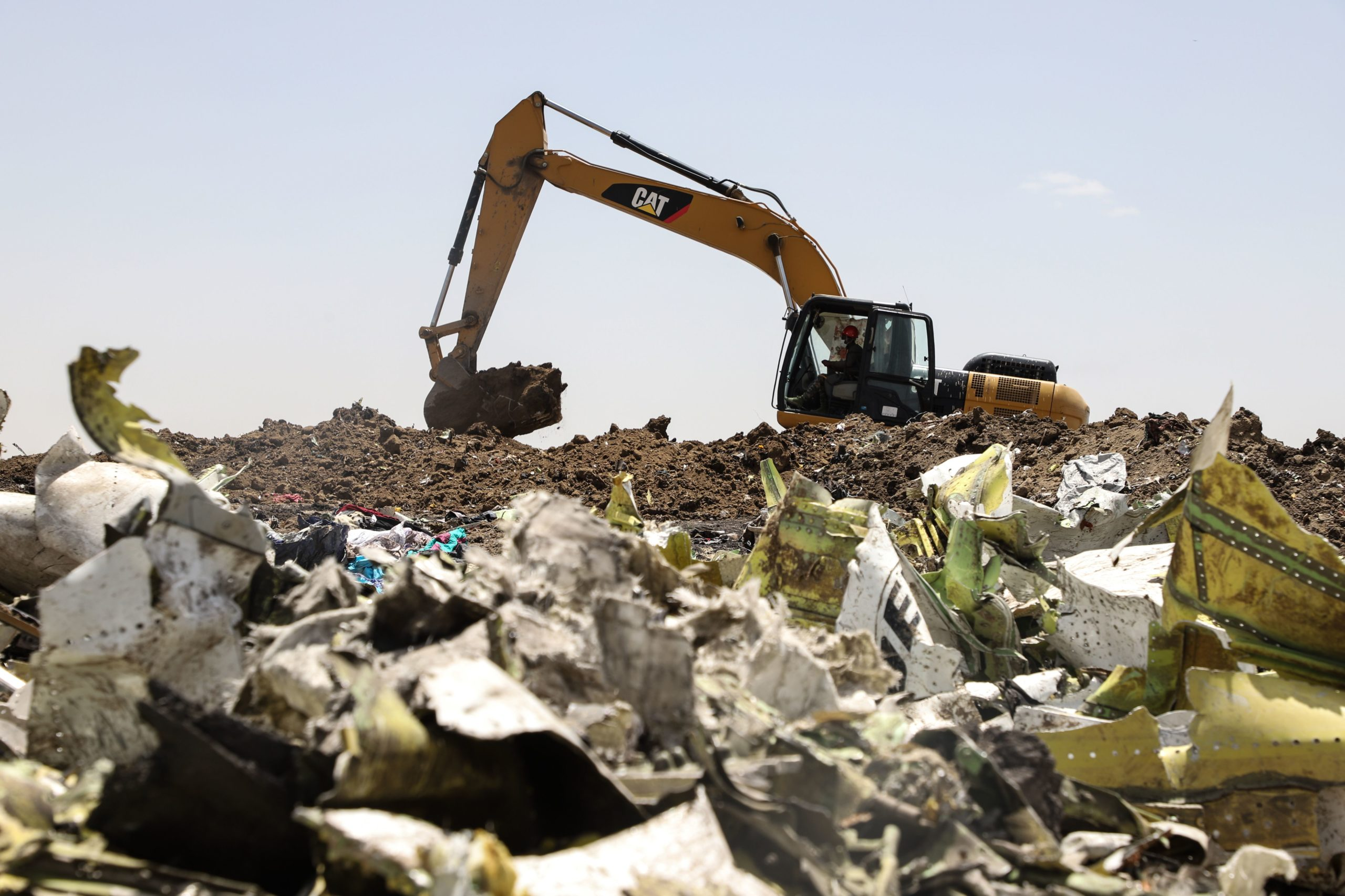 A power shovel digs at the crash site of Ethiopia Airlines near Bishoftu, a town some 60 kilometres southeast of Addis Ababa, Ethiopia, on March 11, 2019. - Airlines in Ethiopia, China and Indonesia grounded Boeing 737 MAX 8 jets Monday as investigators recovered the black boxes from a brand-new passenger jet that crashed outside Addis Ababa a day earlier, killing all 157 people on board. (Photo by Michael TEWELDE / AFP) (Photo credit should read MICHAEL TEWELDE/AFP via Getty Images)
