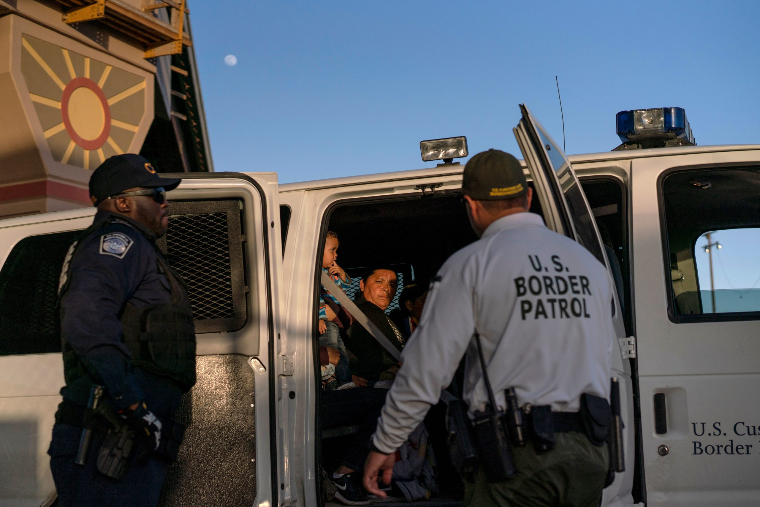 Migrants, mostly from Central America, board a van which will take them to a processing center, on May 16, 2019, in El Paso, Texas. - About 1,100 migrants from Central America and other countries are crossing into the El Paso border sector each day. US Customs and Border Protection Public Information Officer Frank Pino, says that Border Patrol resources and personnel are being stretched by the ongoing migrant crisis, and that the real targets of the Border Patrol are slipping through the cracks. (Photo by Paul Ratje / AFP) (Photo credit should read PAUL RATJE/AFP via Getty Images)