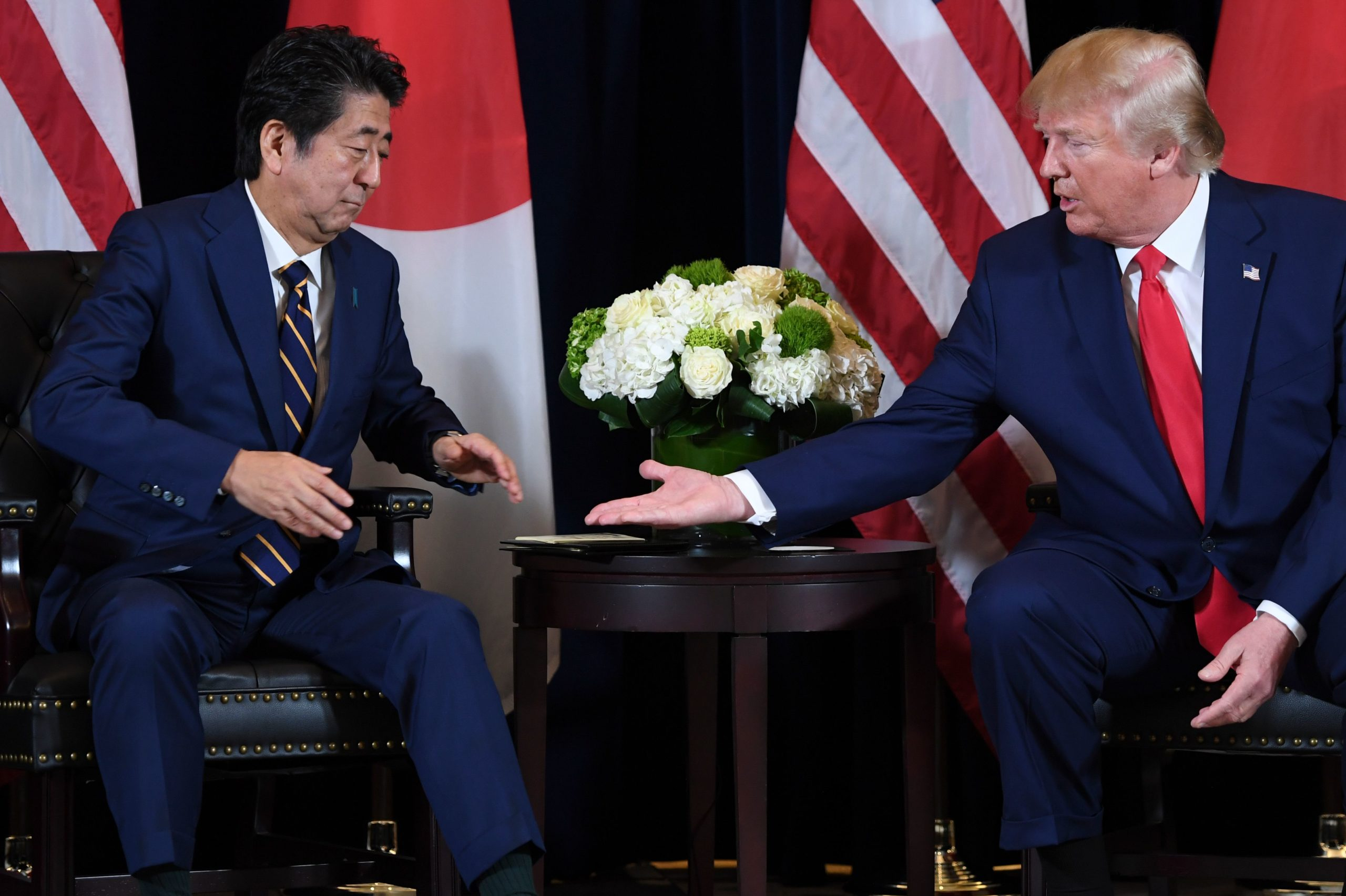 President Donald Trump and former Japanese Prime Minister Shinzo Abe shake hands during a meeting in New York on Sept. 25, 2019. (Saul Loeb/AFP via Getty Images)