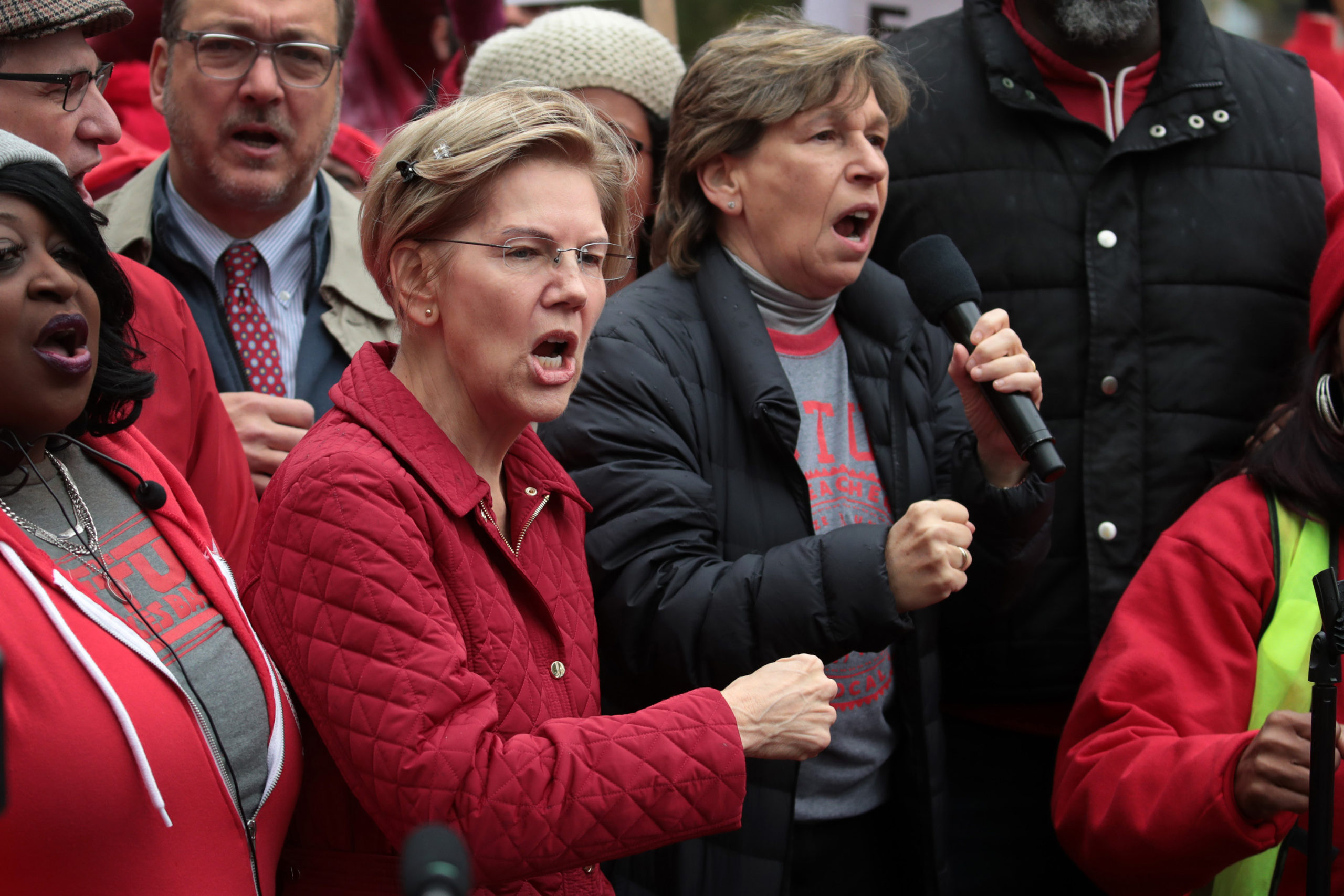 CHICAGO, ILLINOIS - OCTOBER 22: Democratic presidential candidate Sen. Elizabeth Warren (D-MA) (L) and American Federation of Teachers (AFT) president Randi Weingarten visit with striking Chicago teachers at Oscar DePriest Elementary School on October 22, 2019 in Chicago, Illinois. About 25,000 Chicago school teachers went on strike last week after the Chicago Teachers Union (CTU) failed to reach a contract agreement with the city. With about 300,000 students, Chicago has the third largest public school system in the nation. (Photo by Scott Olson/Getty Images)