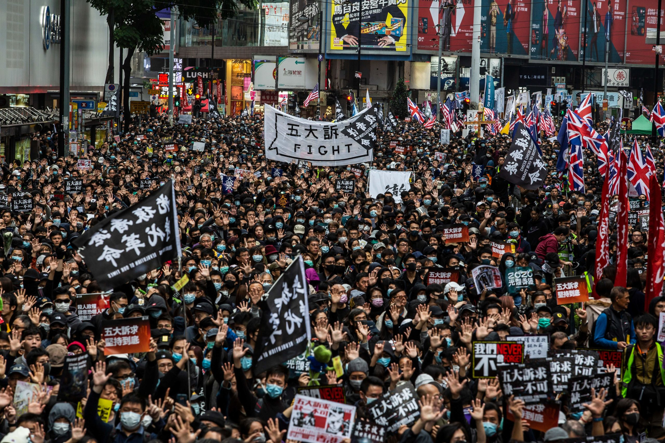 TOPSHOT - People take part in a pro-democracy march in Hong Kong on January 1, 2020. - Tens of thousands of protesters marched in Hong Kong during a massive pro-democracy rally on New Year's Day, looking to carry the momentum of their movement into 2020. (Photo by ISAAC LAWRENCE / AFP) (Photo by ISAAC LAWRENCE/AFP via Getty Images)