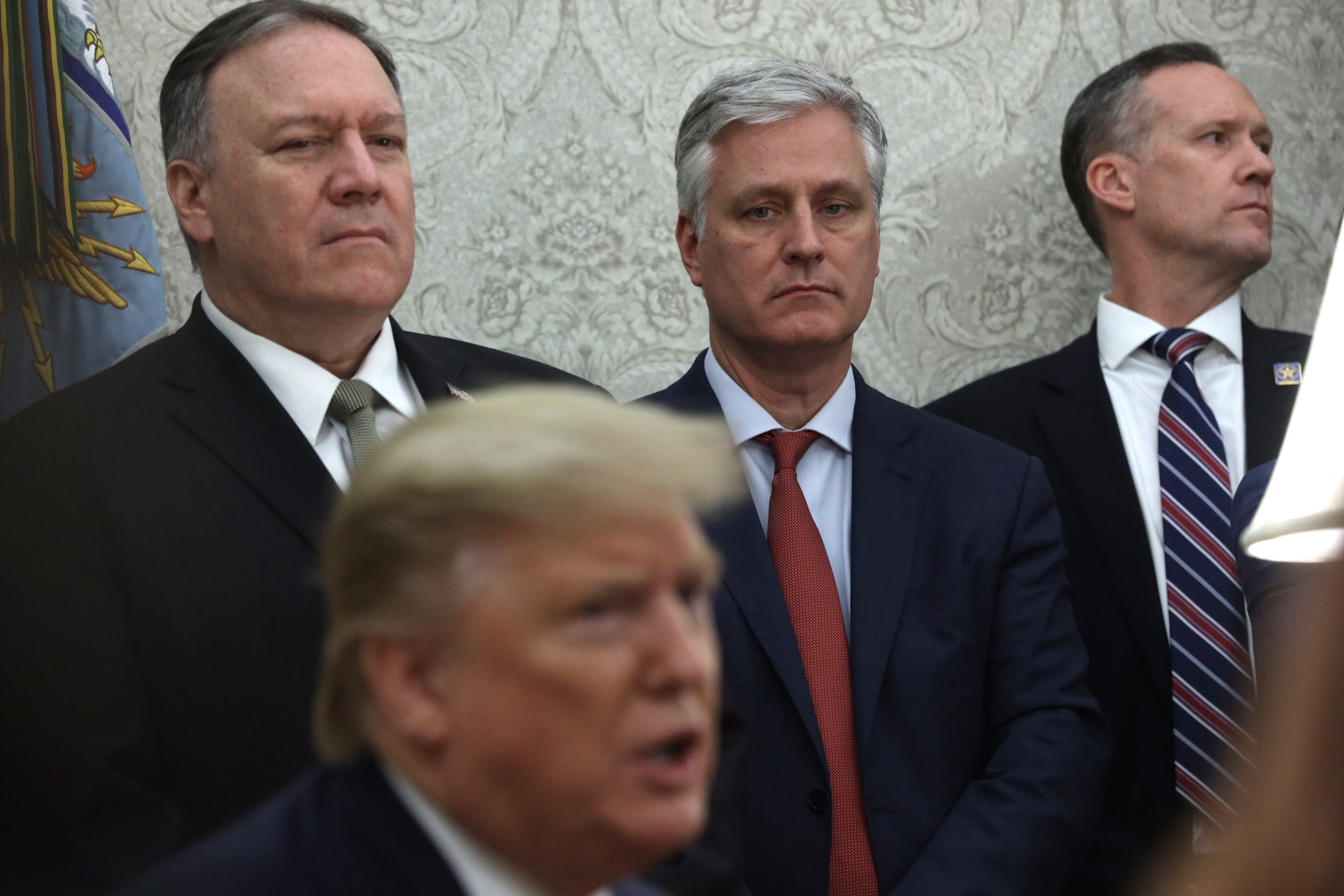 WASHINGTON, DC - DECEMBER 17: U.S. President Donald Trump speaks as Secretary of State Mike Pompeo, and National Security Adviser Robert O'Brien listen during a meeting with Guatemalan President Jimmy Morales in the Oval Office of the White House December 17, 2019 in Washington, DC. President Morales is the first Central American leader to sign and implement the Asylum Cooperation Agreement with the U.S. (Photo by Alex Wong/Getty Images)