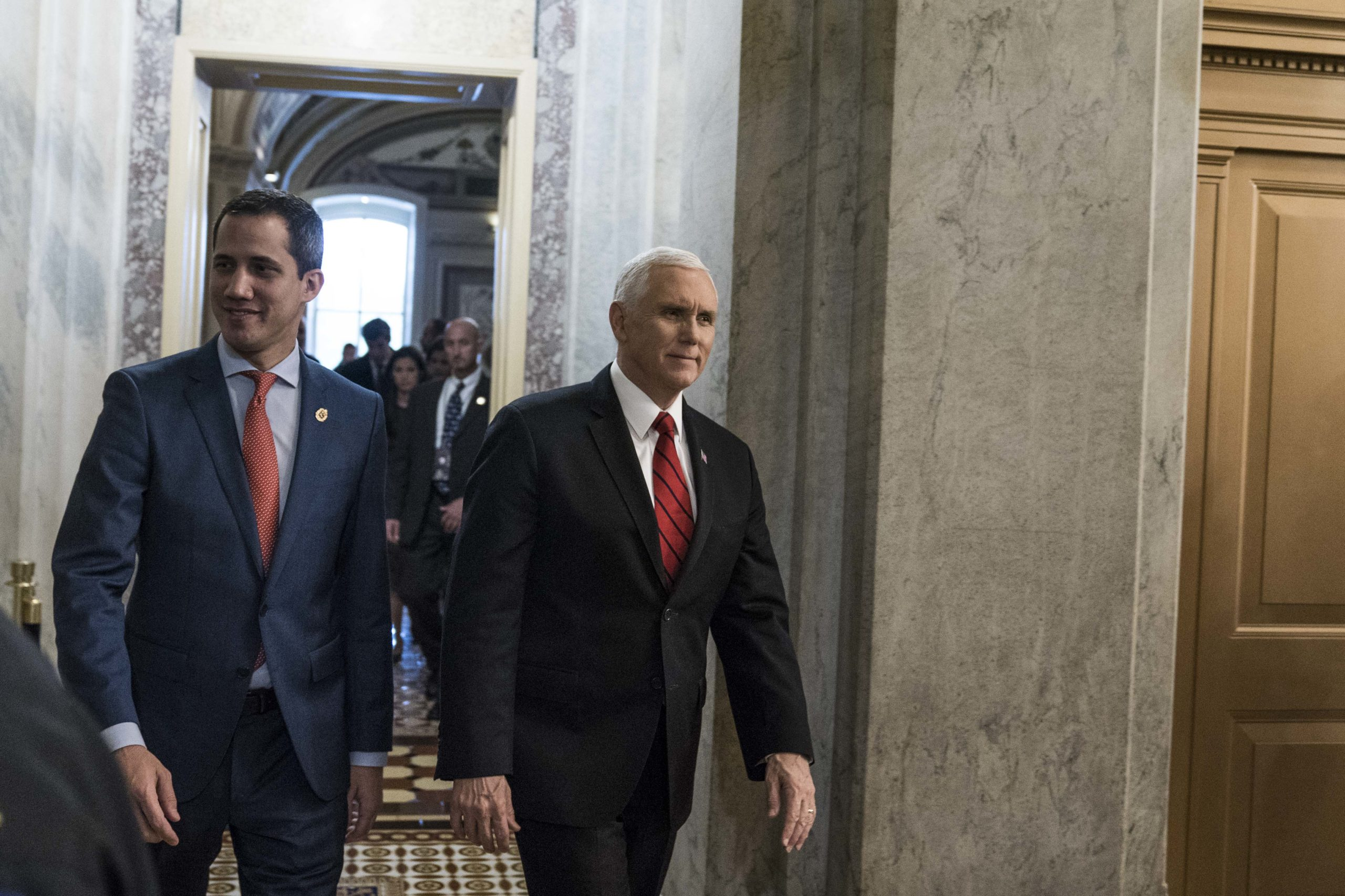 Vice President Mike Pence and Venezuelan opposition leader Juan Guaidó depart from the U.S. Capitol on Feb. 5, 2020. (Sarah Silbiger/Getty Images)