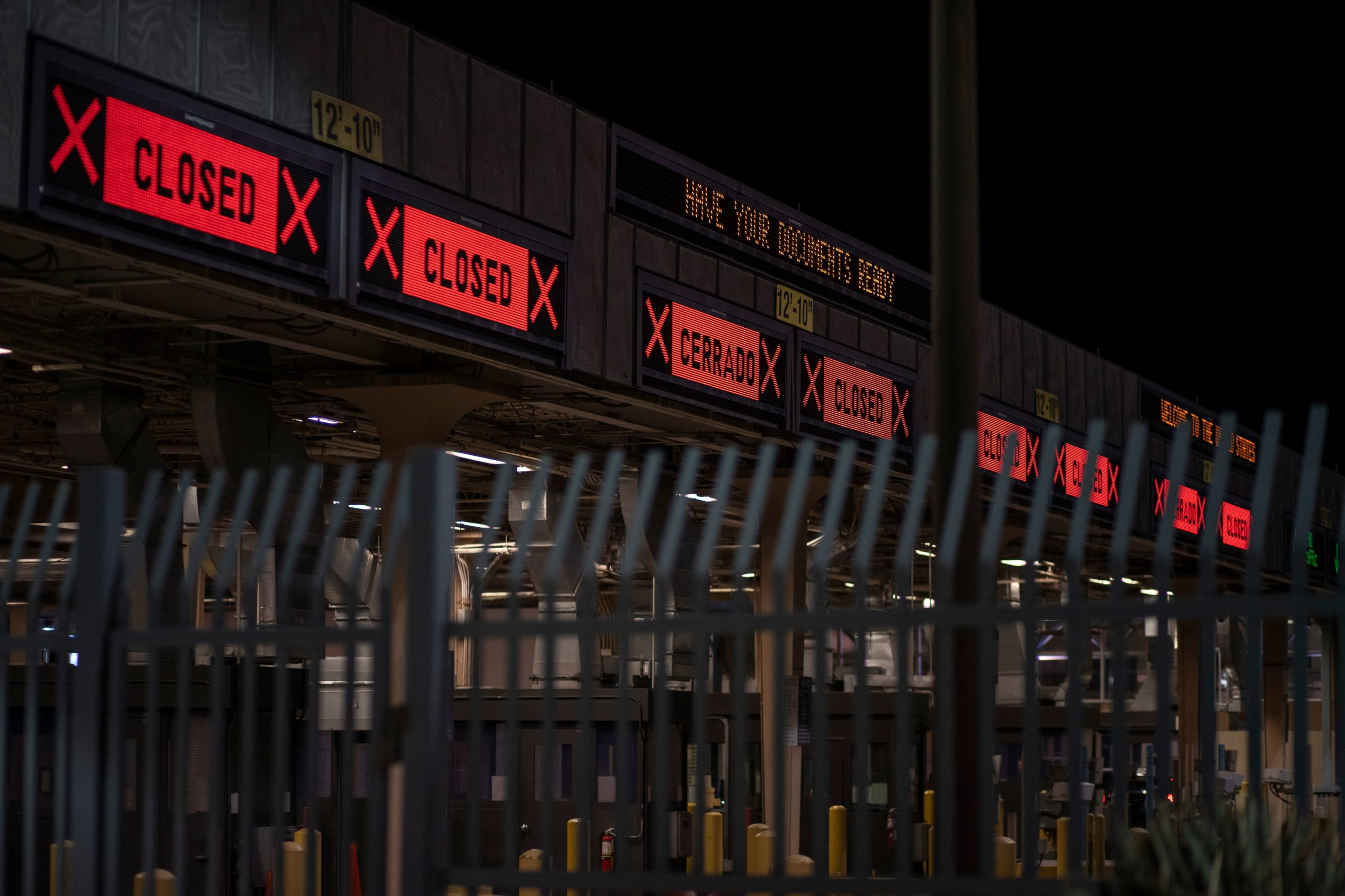 """In efforts to control the outbreak of COVID-19, The United States-Mexico border was closed to non-essential traffic at midnight on March 21, 2020 in El Paso, Texas. - US President Donald Trump announced on March 20, 2020, that the US and Mexico have agreed to restrict non-essential travel across their border beginning on March 21. He said the move, similar to one already announced with northern neighbor Canada, was necessary to prevent the """"spread the infection to our border agents, migrants, and to the public at large."""" (Photo by Paul Ratje / Agence France-Presse / AFP) (Photo by PAUL RATJE/Agence France-Presse/AFP via Getty Images)"""
