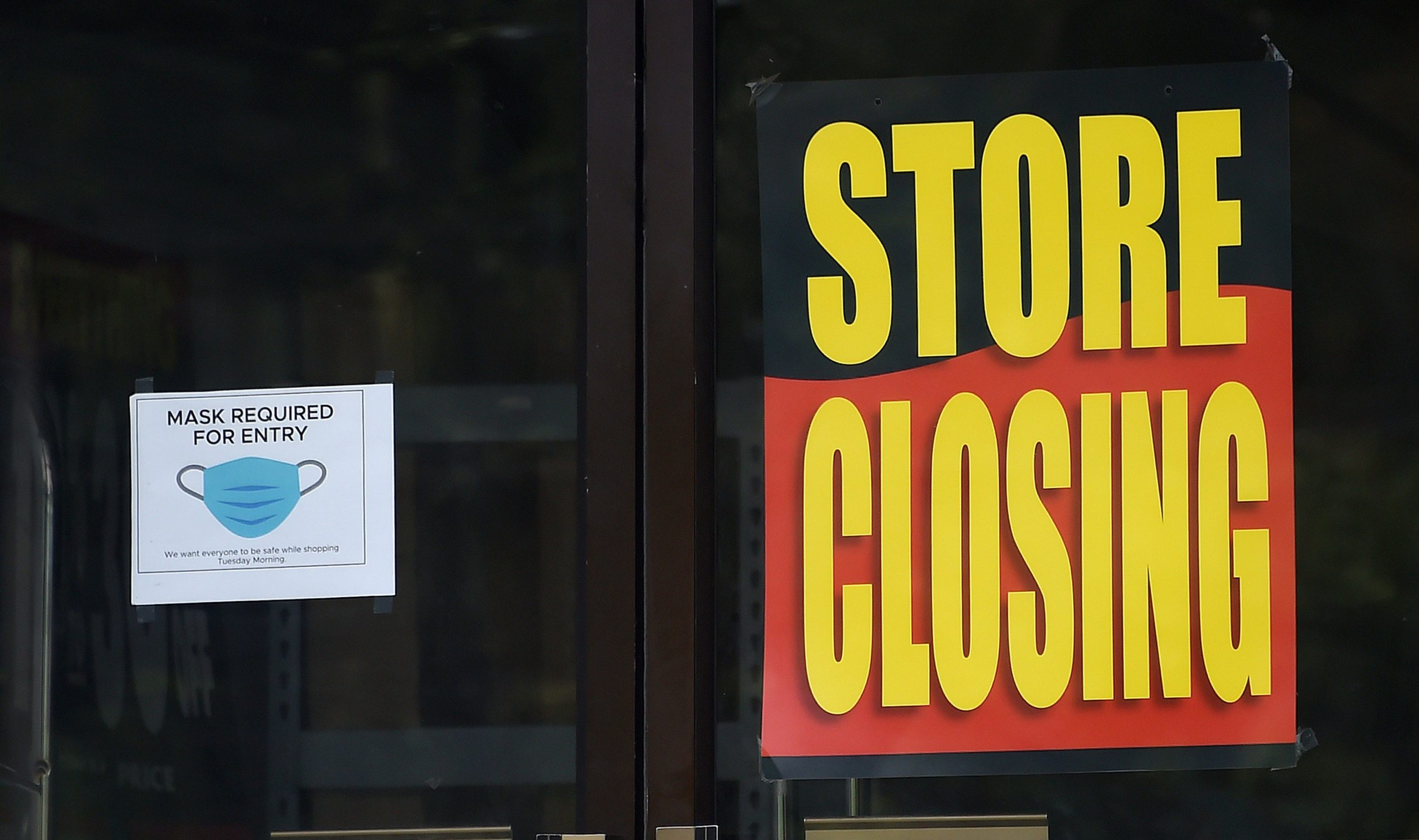 A store displays a sign before closing down permanently as more businesses feel the effects of stay-at-home orders amid the coronavirus pandemic, on June 16, 2020 in Arlington, Virginia. (Photo by Olivier DOULIERY / AFP) (Photo by OLIVIER DOULIERY/AFP via Getty Images)