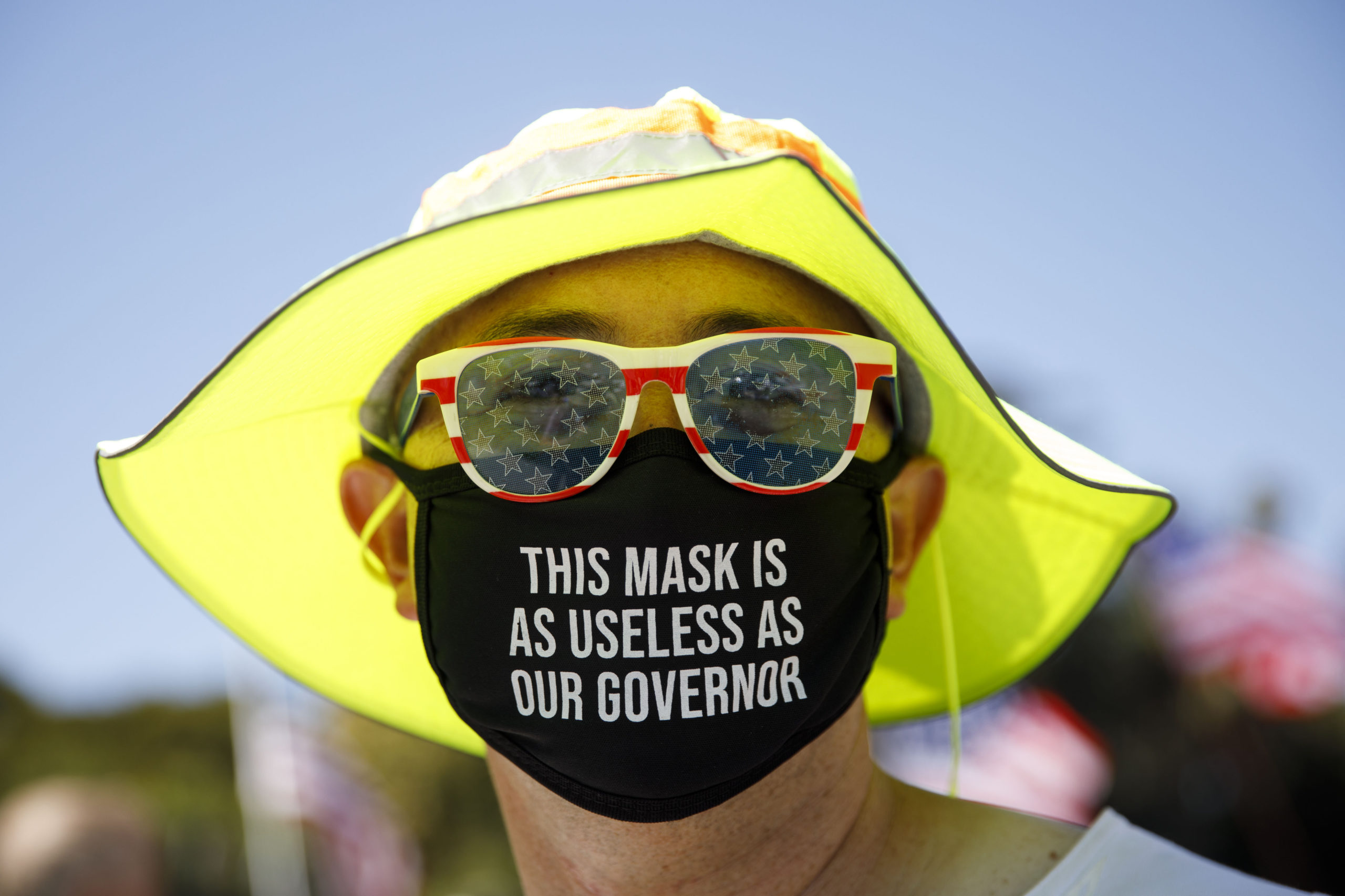 A demonstrator wears a facemask referring to the governor of California during a WalkAway rally in support of the US president on August 8, 2020 in Beverly Hills, California. (Photo by Patrick T. Fallon / AFP) (Photo by PATRICK T. FALLON/AFP via Getty Images)