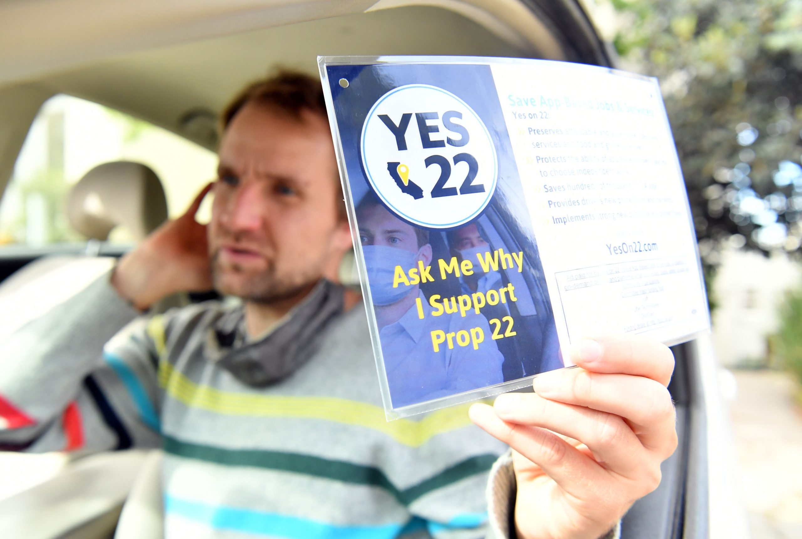 Uber driver Sergei Fyodorov discusses why he supports a yes vote on Proposition 22 in Oakland, California on Oct. 9, 2020. (Josh Edelson/AFP via Getty Images)