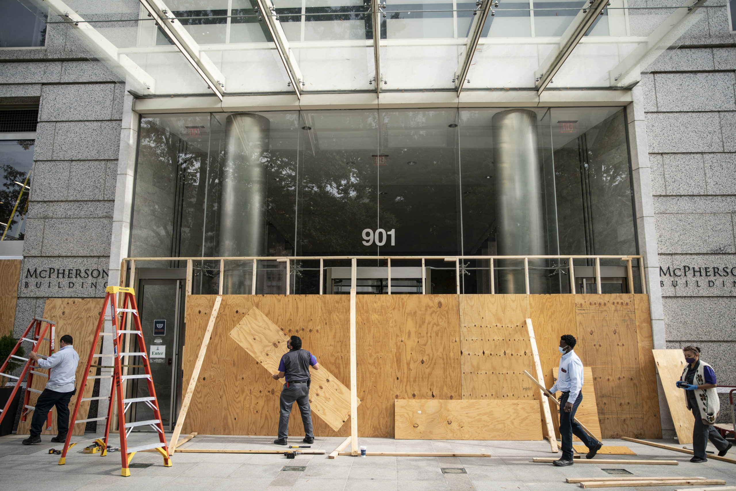 WASHINGTON, DC - OCTOBER 28: Protective wood boards are placed on the front of the McPherson Building on October 28, 2020 near the White House in Washington, DC. Businesses are preparing for possible demonstrations following next week's presidential election. (Photo by Sarah Silbiger/Getty Images)