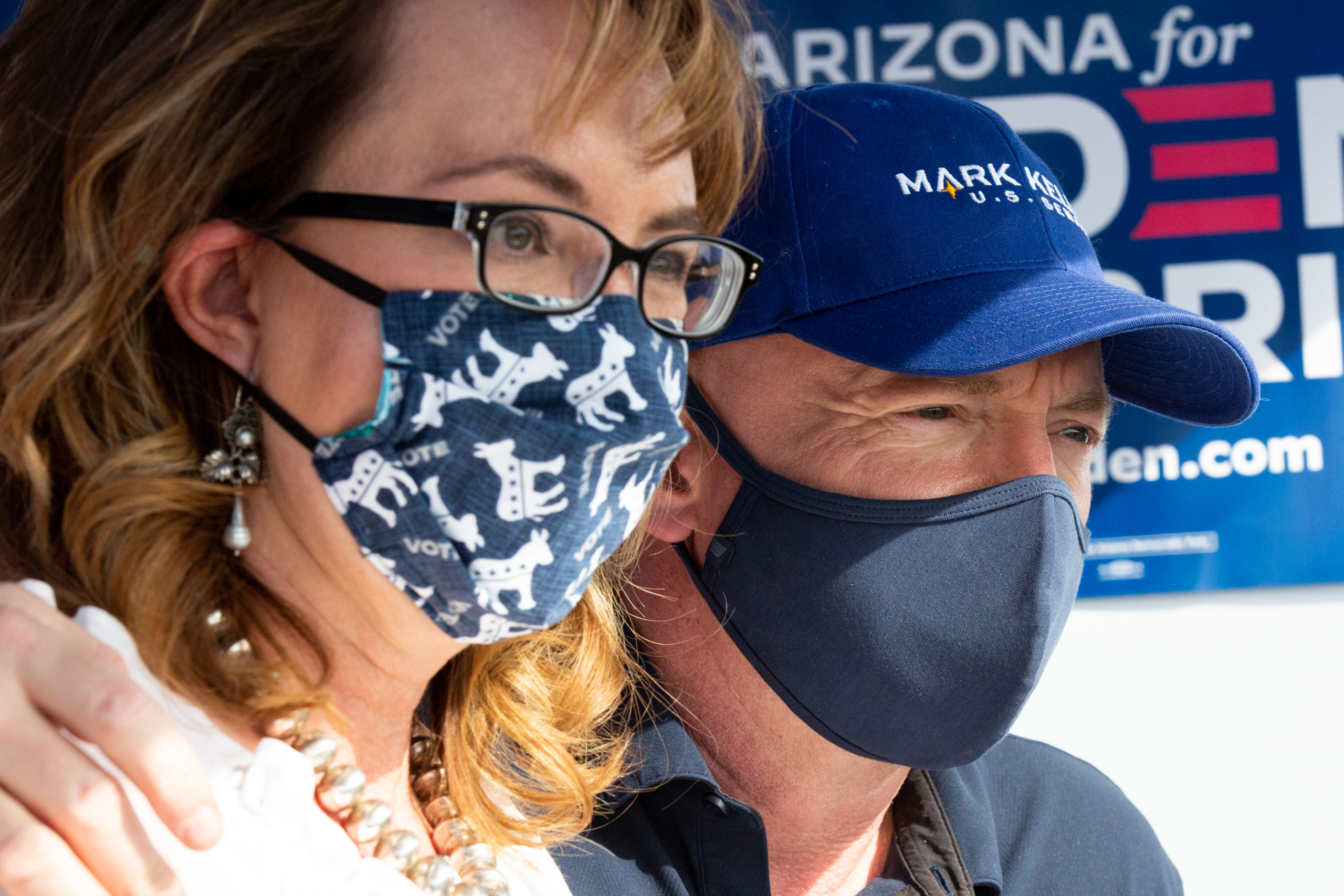 PHOENIX, AZ - OCTOBER 30: U.S. Democratic Senate candidate Mark Kelly and former Arizona congresswoman Gabrielle Giffords greet voters on the last day of early voting at Mountain Park Health Center on October 30, 2020 in Phoenix, Arizona. (Photo by Courtney Pedroza/Getty Images)