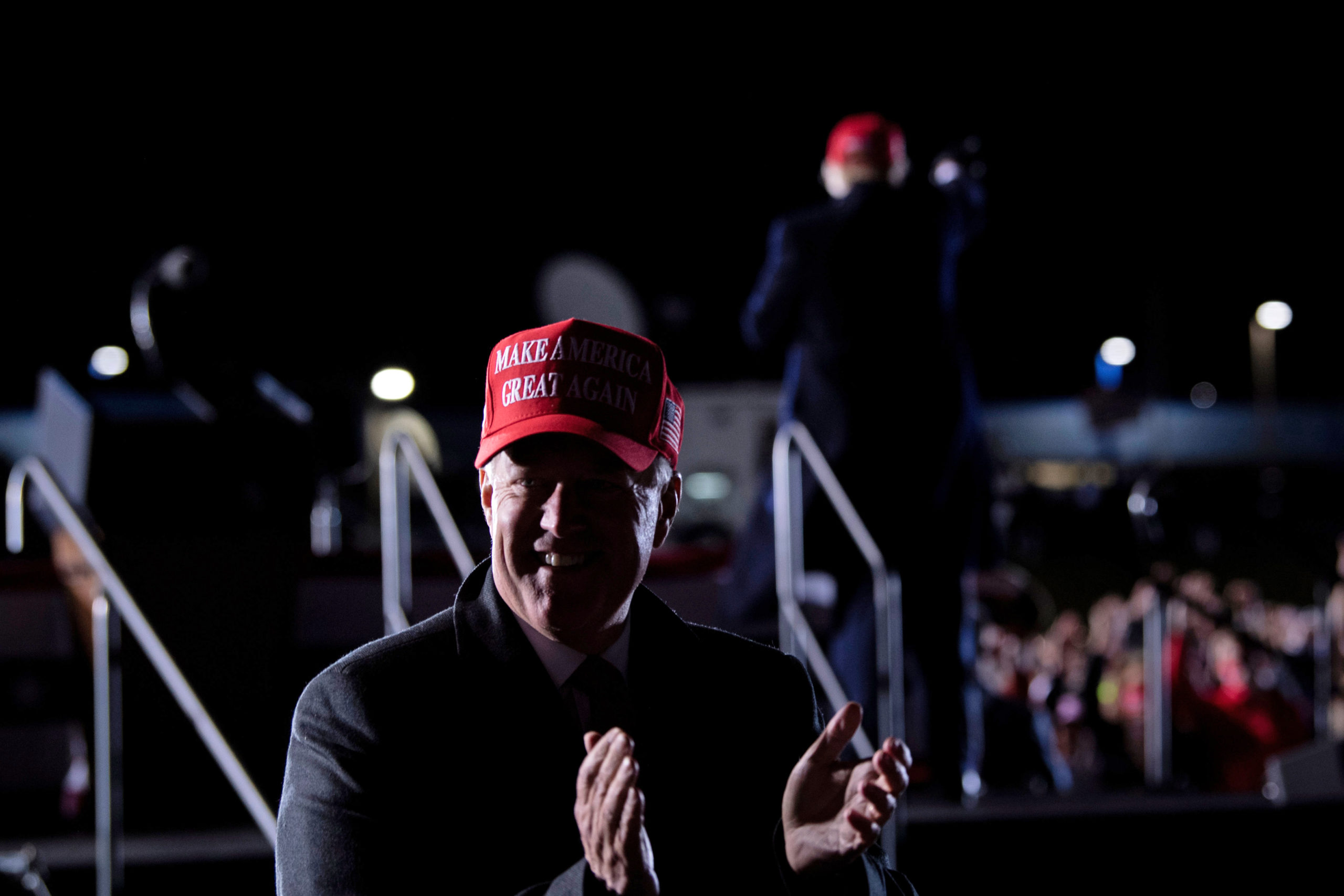 White House Chief of Staff Mark Meadows (L) claps as US President Donald Trump leaves after speaking during a Make America Great Again rally at Hickory Regional Airport in Hickory, North Carolina on November 1, 2020. (Photo by BRENDAN SMIALOWSKI/AFP via Getty Images)