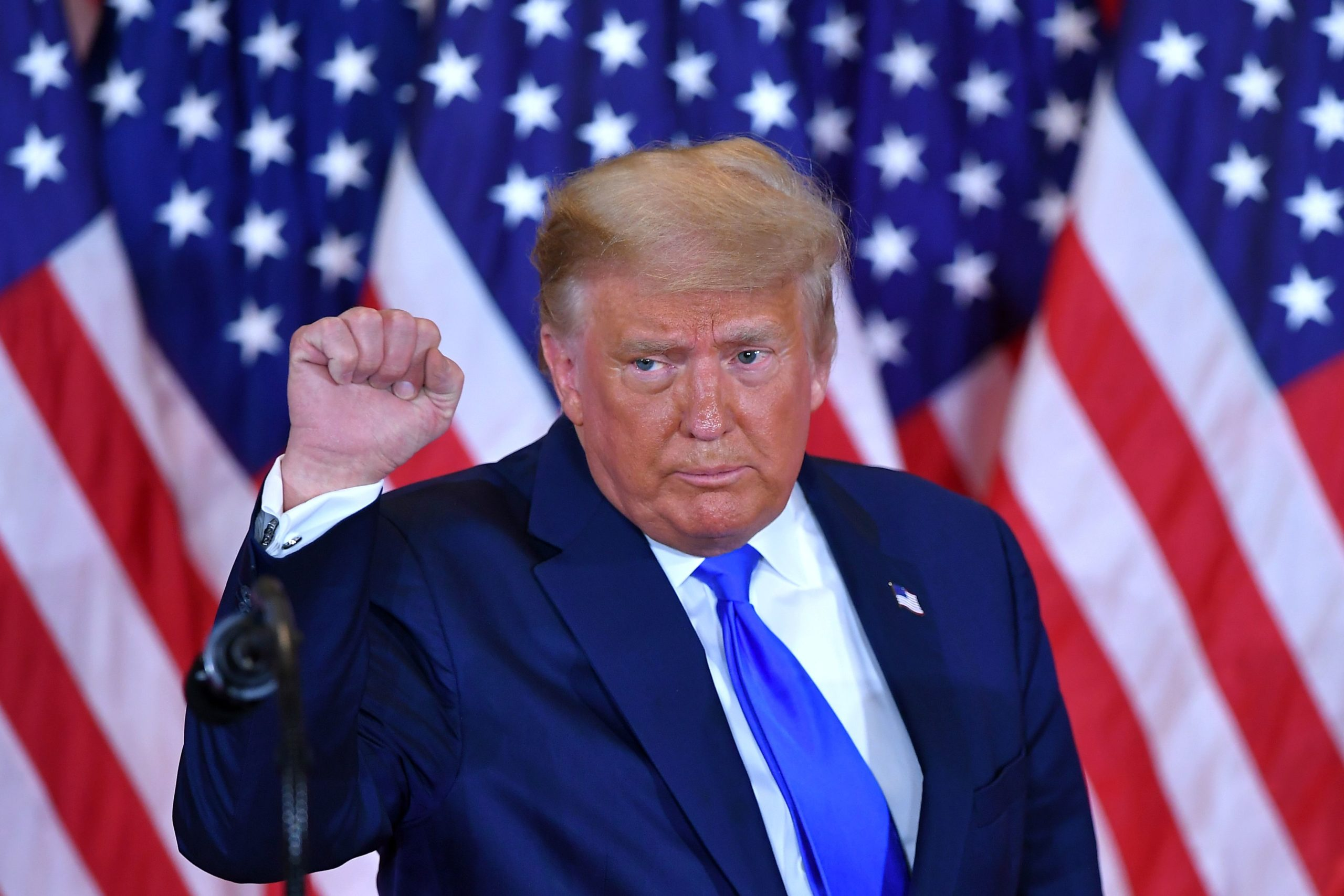 US President Donald Trump pumps his fist after speaking during election night in the East Room of the White House in Washington, DC, early on November 4, 2020. (Photo by MANDEL NGAN/AFP via Getty Images)