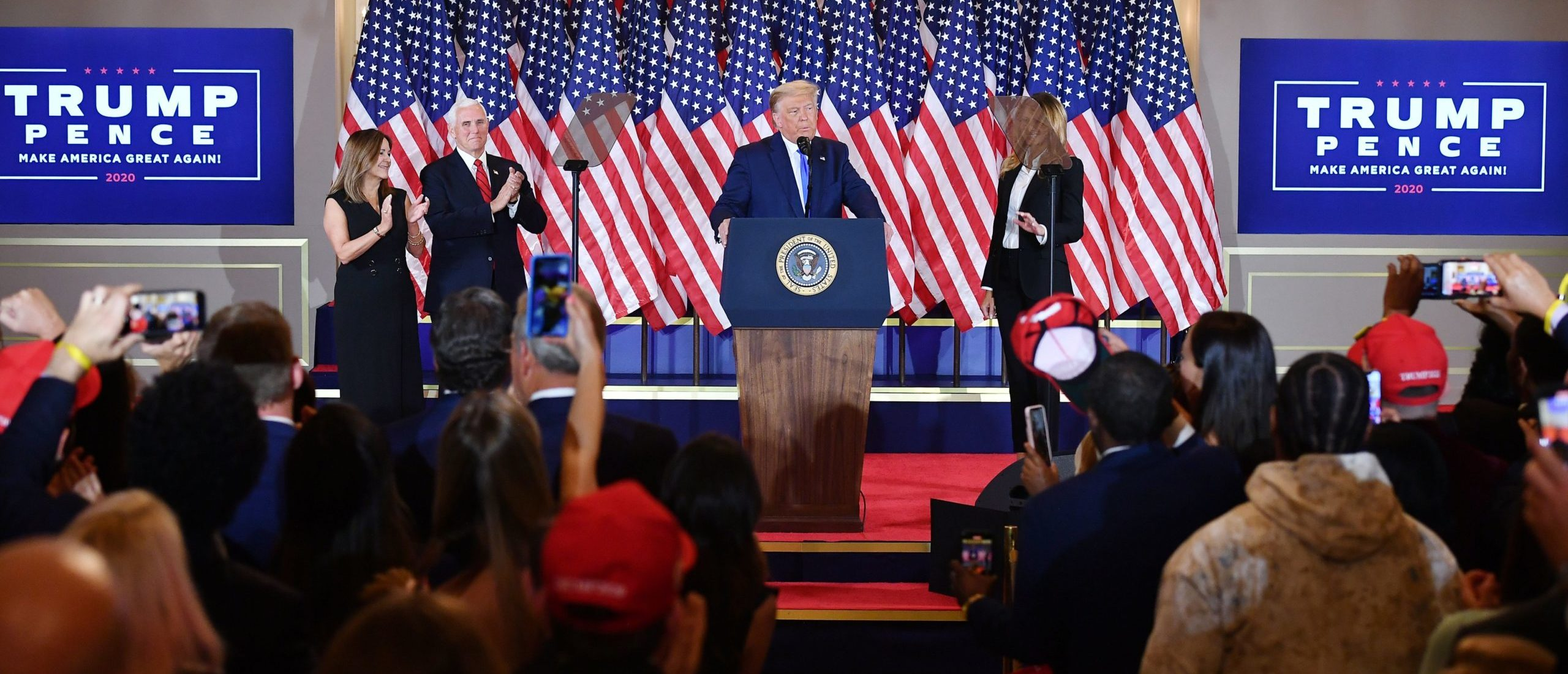 US President Donald Trump, flanked by Karen Pence (L), US Vice President Mike Pence (2nd L) and US First Lady Melania Trump (R), speaks during election night in the East Room of the White House in Washington, DC, early on November 4, 2020. (Photo by MANDEL NGAN/AFP via Getty Images)