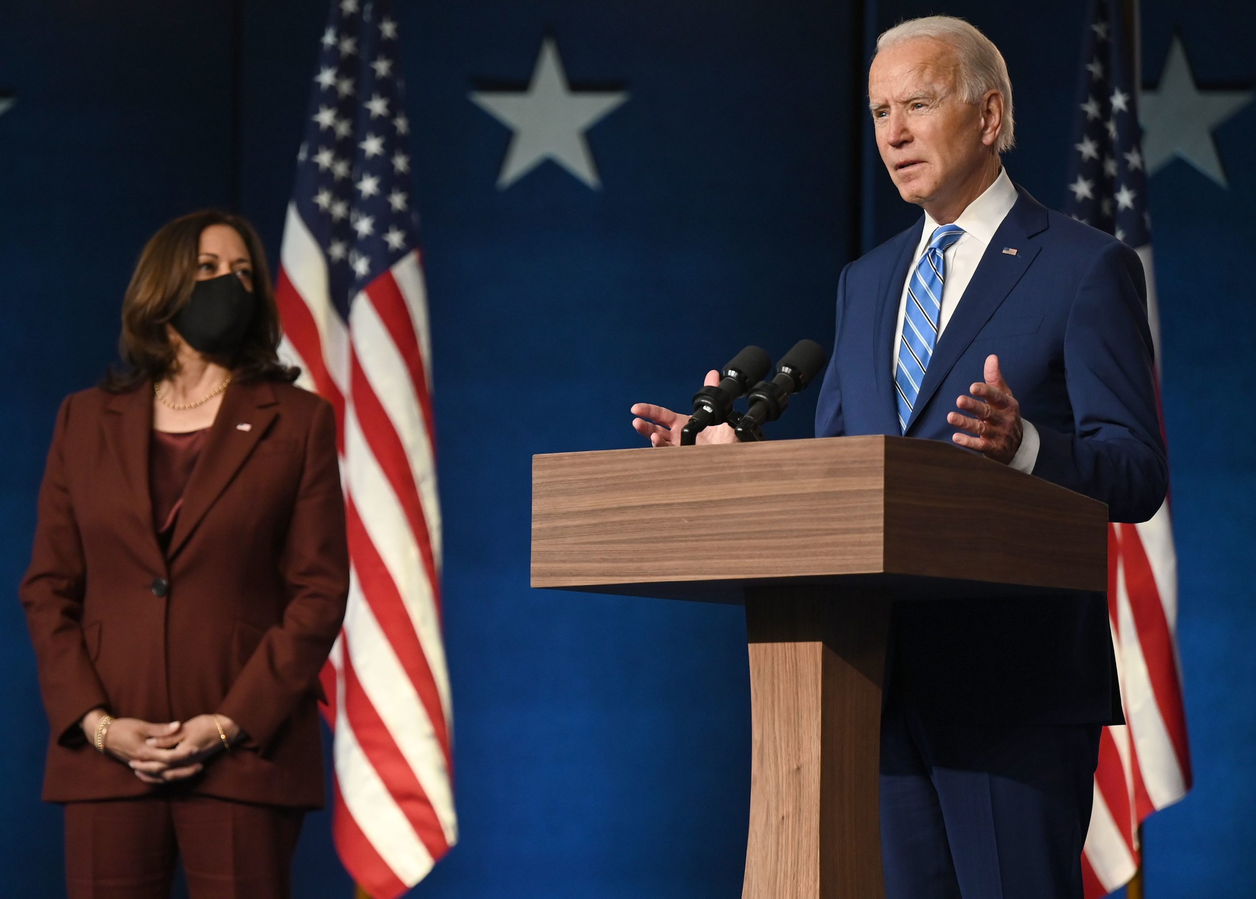 Democratic Presidential candidate Joe Biden speaks as US Senator and Vice-Presidential candidate, Kamala Harris, looks on at the Chase Center in Wilmington, Delaware on November 4, 2020. - President Donald Trump and Democratic challenger Joe Biden are squaring off for what could be a legal battle for the White House, running neck-and-neck in the electoral vote count, and several battleground states still in play on November 4. (Photo by JIM WATSON/AFP via Getty Images)