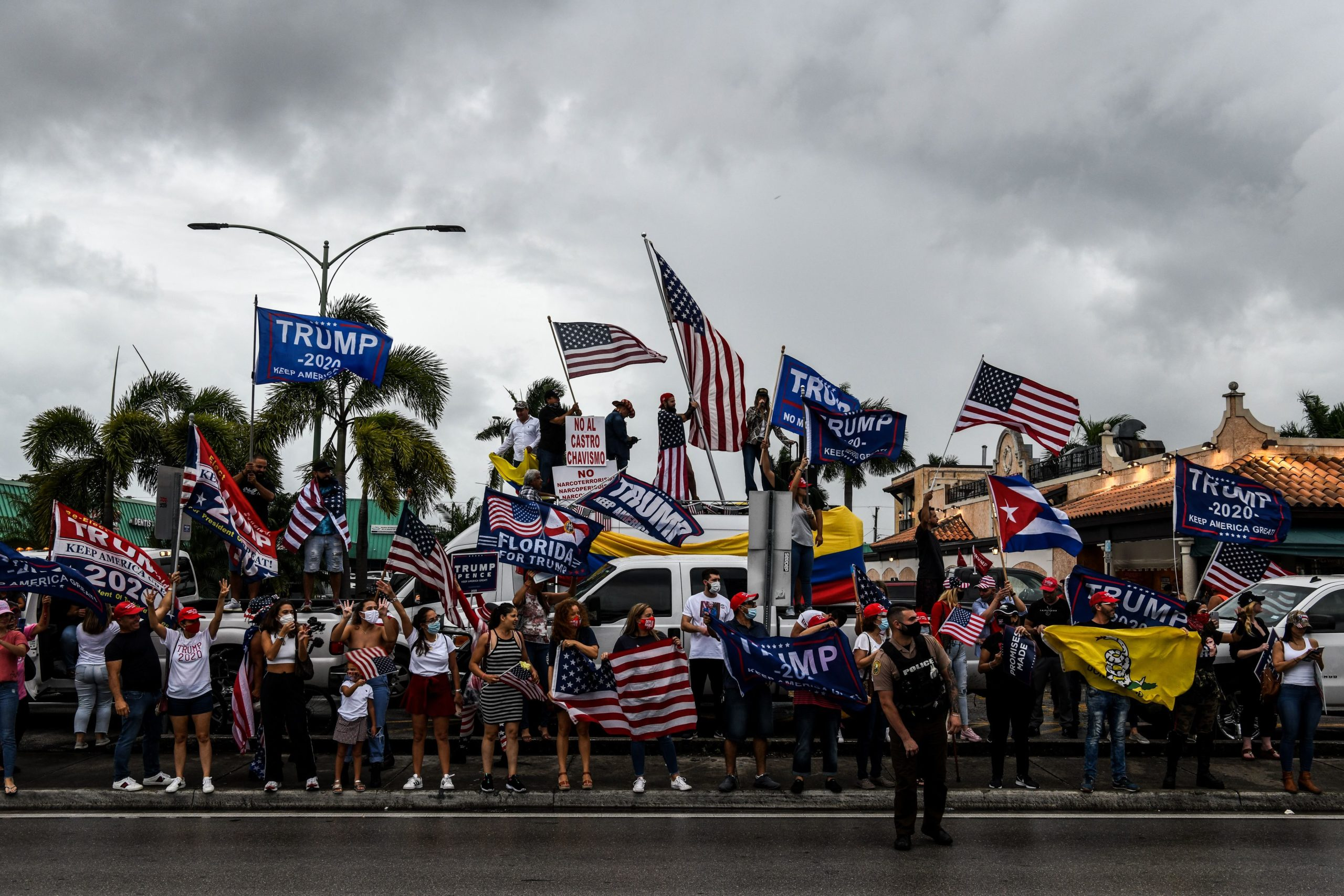 Supporters of US President Donald Trump hold signs and flags during a protest in Miami on November 7, 2020, after Joe Biden was declared the winner of the 2020 presidential election. - Democrat Joe Biden has won the White House, US media said November 7, defeating Donald Trump and ending a presidency that convulsed American politics, shocked the world and left the United States more divided than at any time in decades. (Photo by CHANDAN KHANNA / AFP) (Photo by CHANDAN KHANNA/AFP via Getty Images)