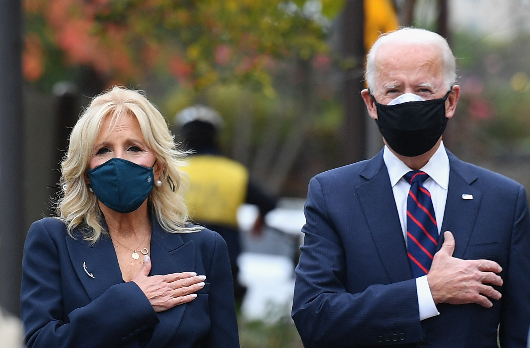 US President-elect Joe Biden and his wife Jill Biden pay their respects during a Veterans Day stop at the Korean War Memorial Park in Philadelphia, Pennsylvania on November 11, 2020. - The leaders of close US allies on November 10, 2020 telephoned President-elect Joe Biden and pledged to work together but in an extraordinary break, America's top diplomat Mike Pompeo insisted that Donald Trump would remain in power. The transition team said Biden planned to work with the Europeans on fighting the Covid-19 pandemic as well as climate change -- one of many areas on which Trump sharply differed with the allies. (Photo by ANGELA WEISS/AFP via Getty Images)