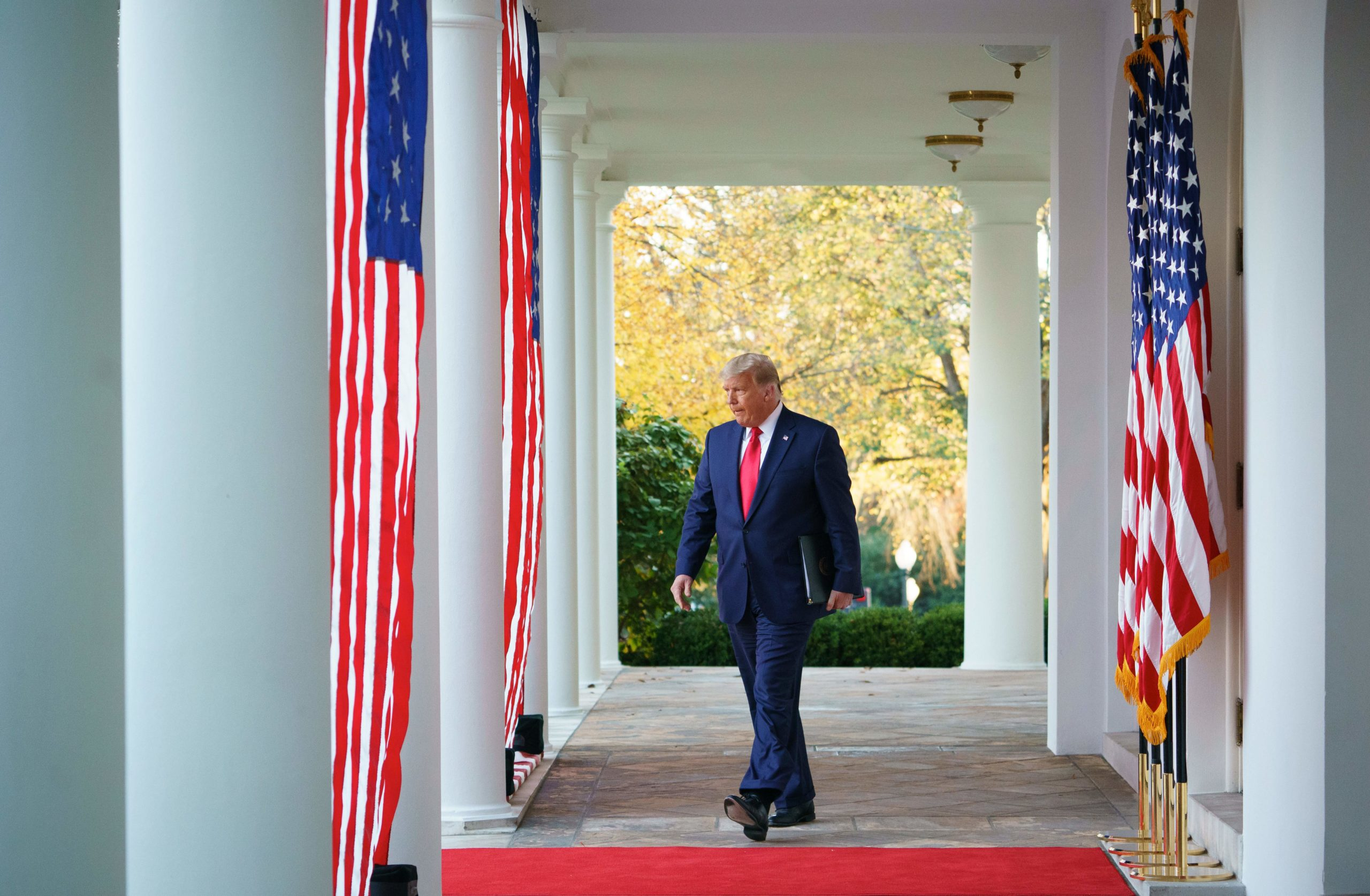 "President Donald Trump arrives to deliver an update on ""Operation Warp Speed"" in the Rose Garden of the White House on Nov. 13. (Mandel Ngan/AFP via Getty Images)"