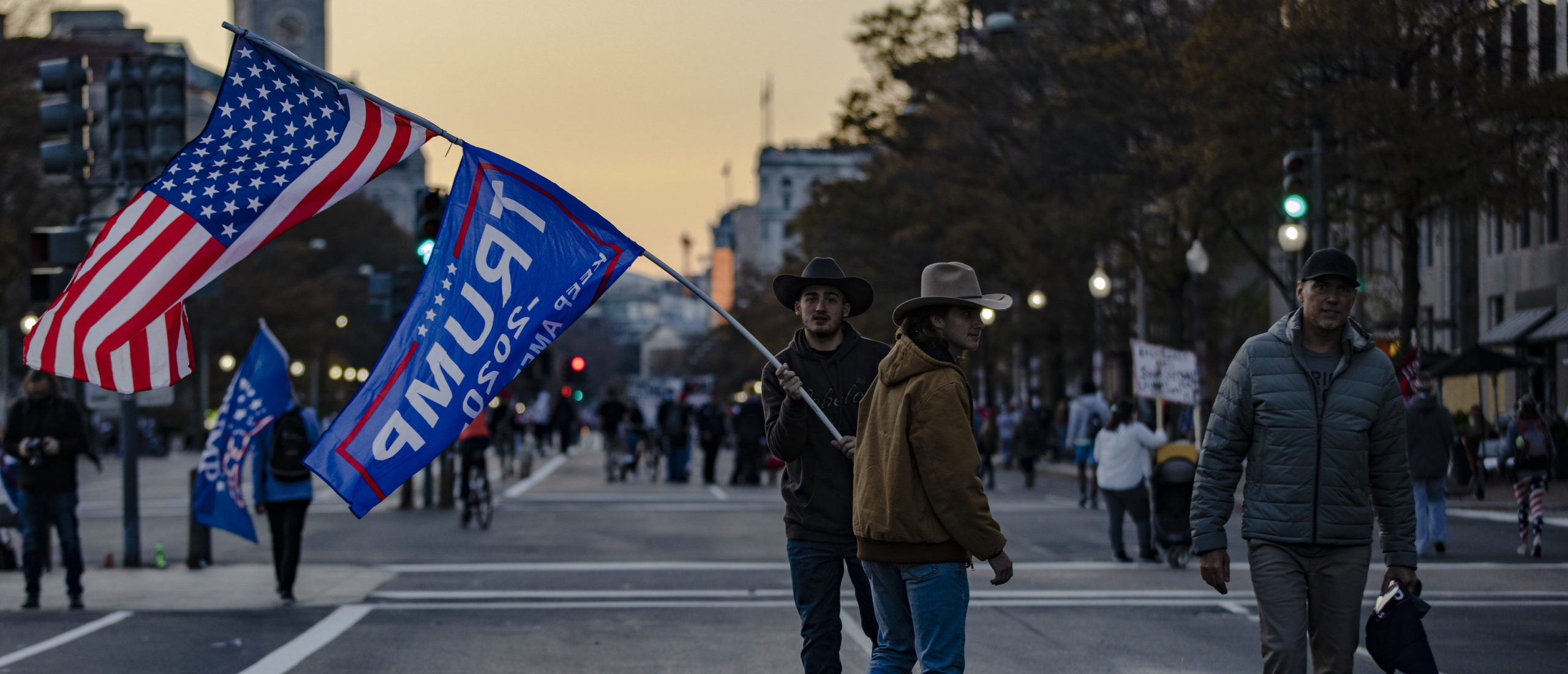 """WASHINGTON, DC - NOVEMBER 14: People walk in the middle of the closed down Pennsylvania Avenue as the """"Million MAGA March"""" comes to a close on November 14, 2020 in Washington, DC. Various pro-Trump groups gathered in DC today for the """"Million MAGA March"""" to protest the results of the 2020 presidential election. (Photo by Samuel Corum/Getty Images)"""