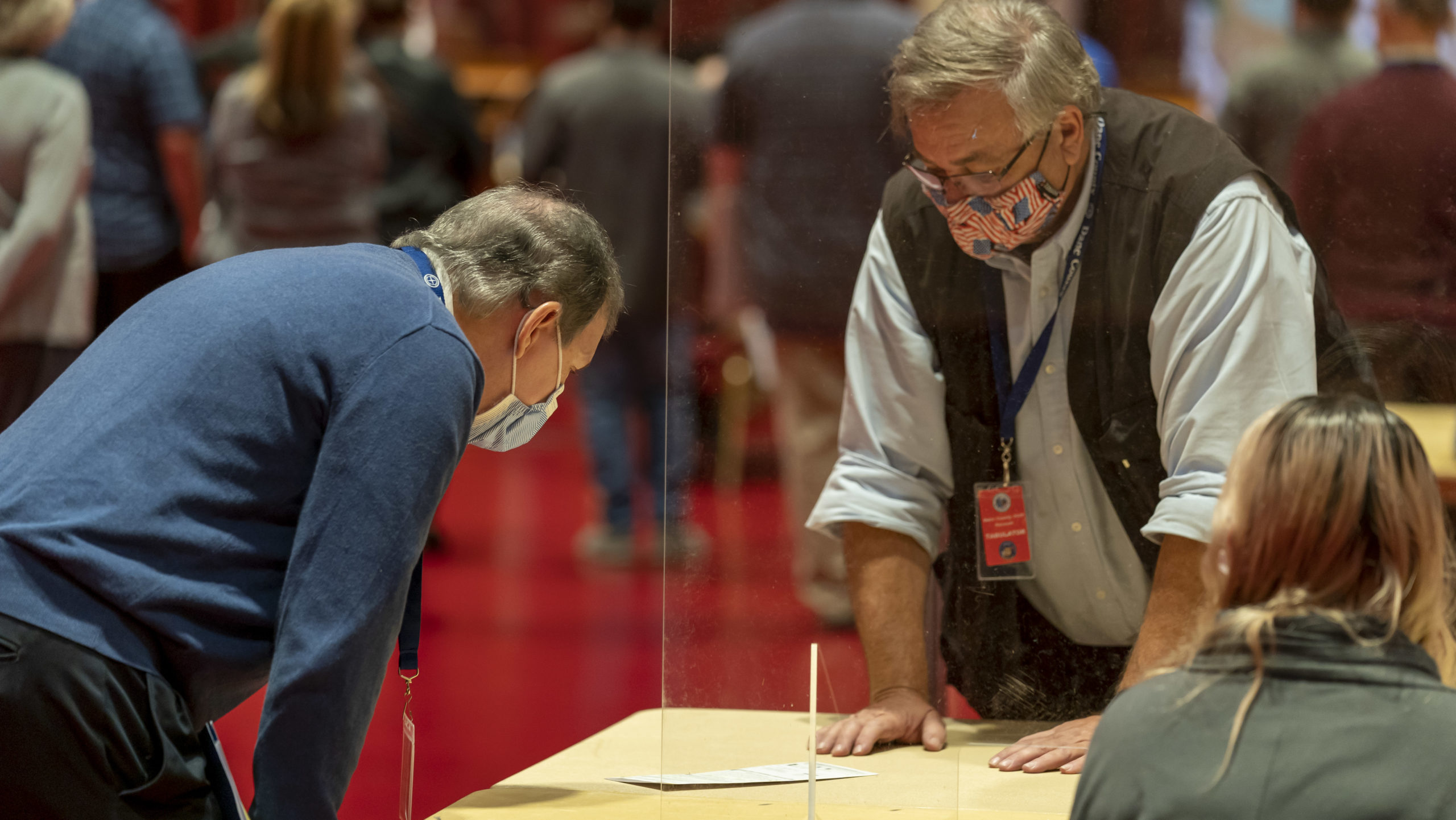 MADISON, WI - NOVEMBER 20: A representative for President Donald Trump, left, looks over a ballot during the presidential recount vote for Dane County on November 20, 2020 in Madison, Wisconsin. President Donald Trump requested a recount of ballots in Milwaukee and Dane counties in Wisconsin, hoping to overturn his narrow defeat in the state to Democratic presidential nominee Joe Biden. Trump's campaign paid the state $3 million to cover the cost of the recount. (Photo by Andy Manis/Getty Images)