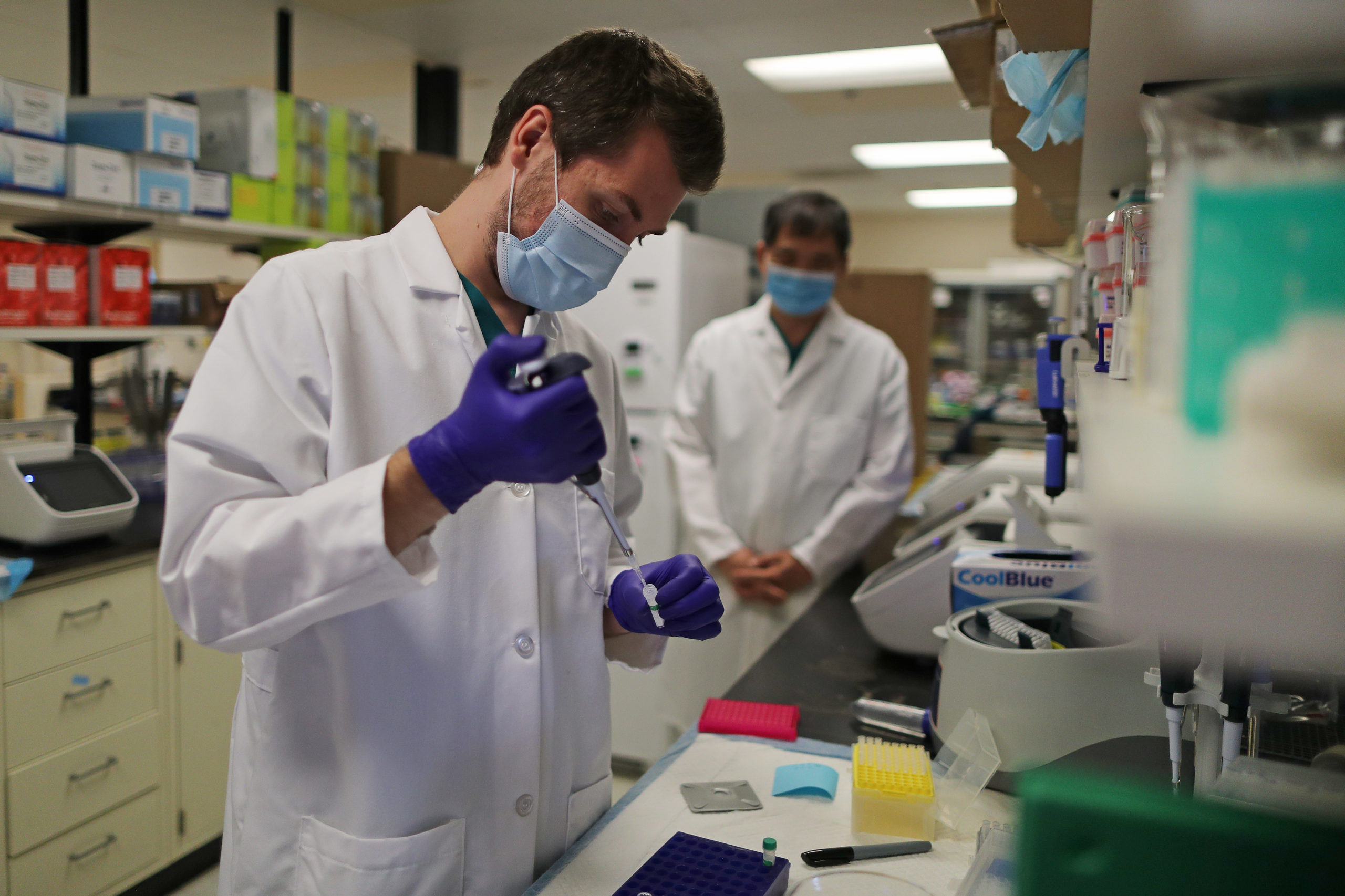 Lab Technician Carter Tavaglione prepares a solution that will be used to process coronavirus test samples at Advagenix, a molecular diagnostics laboratory, on August 05, 2020 in Rockville, Maryland. An advanced genetics testing company, Advagenix has a contract with Montgomery County, Maryland, to test about 1 million people for COVID-19 over the next year. The company is expanding by moving into additional lab space and doubling the size of its workforce to around 30 people to handle the increased work. (Photo by Chip Somodevilla/Getty Images)