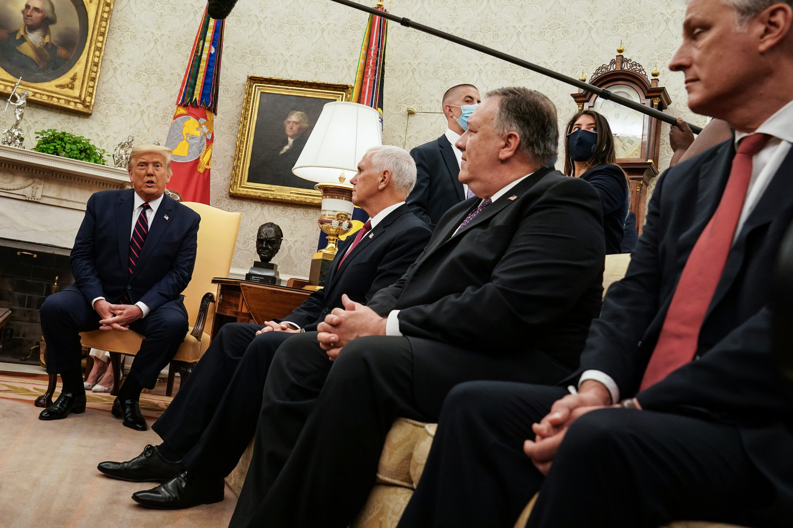 WASHINGTON, DC - AUGUST 20: U.S. President Donald Trump (L) talks to reporters while hosting Iraqi Prime Minister Mustafa Al-Kadhimi (not pictured) and (2nd L-R) Vice President Mike Pence, Secretary of State Mike Pompeo and National Security Advisor Robert O'Brien in the Oval Office at the White House August 20, 2020 in Washington, DC. One day before the meeting, Trump announced that he will allow UN Security Council sanctions to 'snap back' into place against Iran, one of Iraq's neighbors and closest allies, even as U.S. troop levels in Iraq and Syria would most likely shrink in the coming months. (Photo by Anna Moneymaker-Pool/Getty Images)