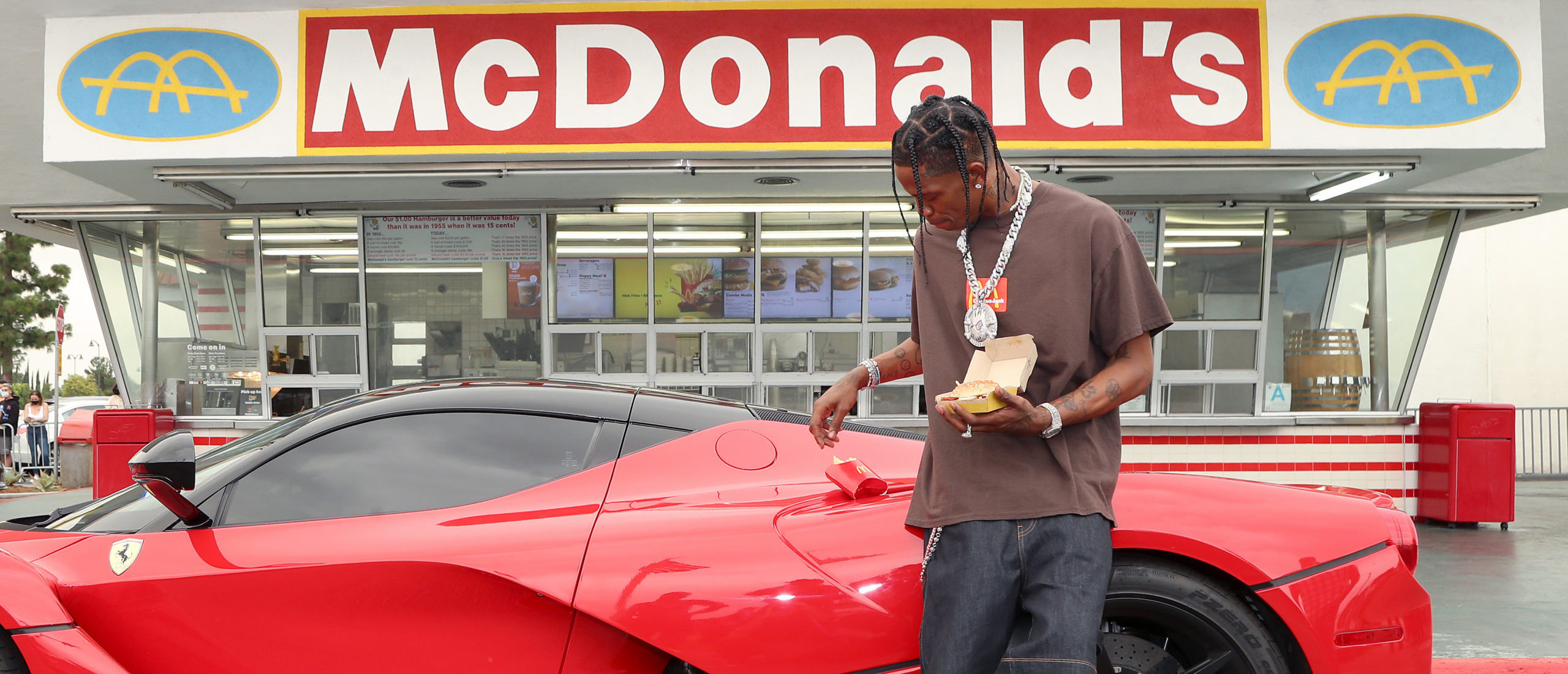 Travis Scott surprises crew and customers at McDonald's for the launch of the Travis Scott Meal in Downey, California. (Photo by Jerritt Clark/Getty Images for McDonald's)