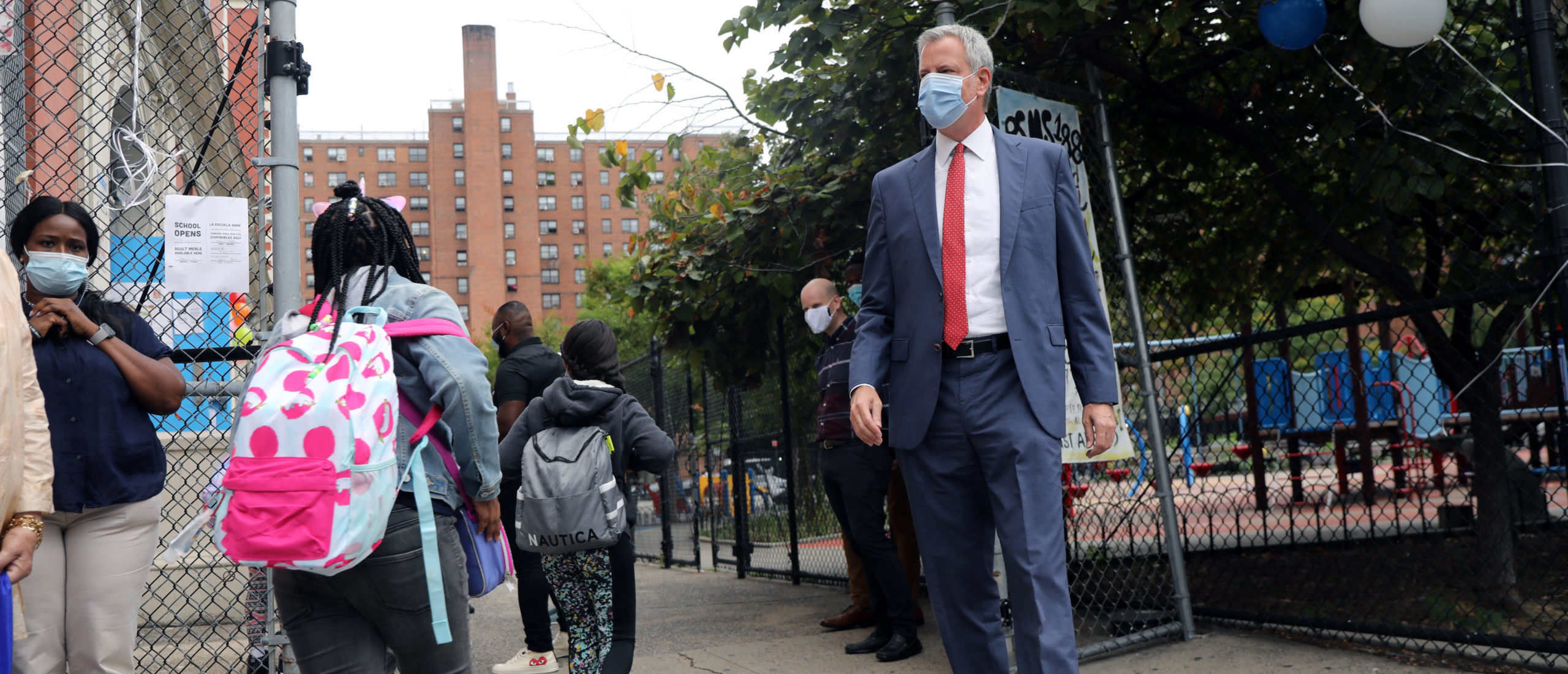 NEW YORK, NEW YORK - SEPTEMBER 29: New York City Mayor Bill de Blasio stands at P.S. 188 as he welcomes elementary school students back to the city's public schools for in-person learning on September 29, 2020 in New York City. Middle and high schoolers will start on Oct. 1 while Pre-K students and students with disabilities could return to school starting on Sept. 21. On Sunday, the executive board of the union representing more than 6,400 of New York City's school leaders passed a unanimous vote of no confidence against Mayor Bill de Blasio and Schools Chancellor Richard Carranza for what they called a failure to lead New York City through the safe and successful reopening of its schools. (Spencer Platt/Getty Images)