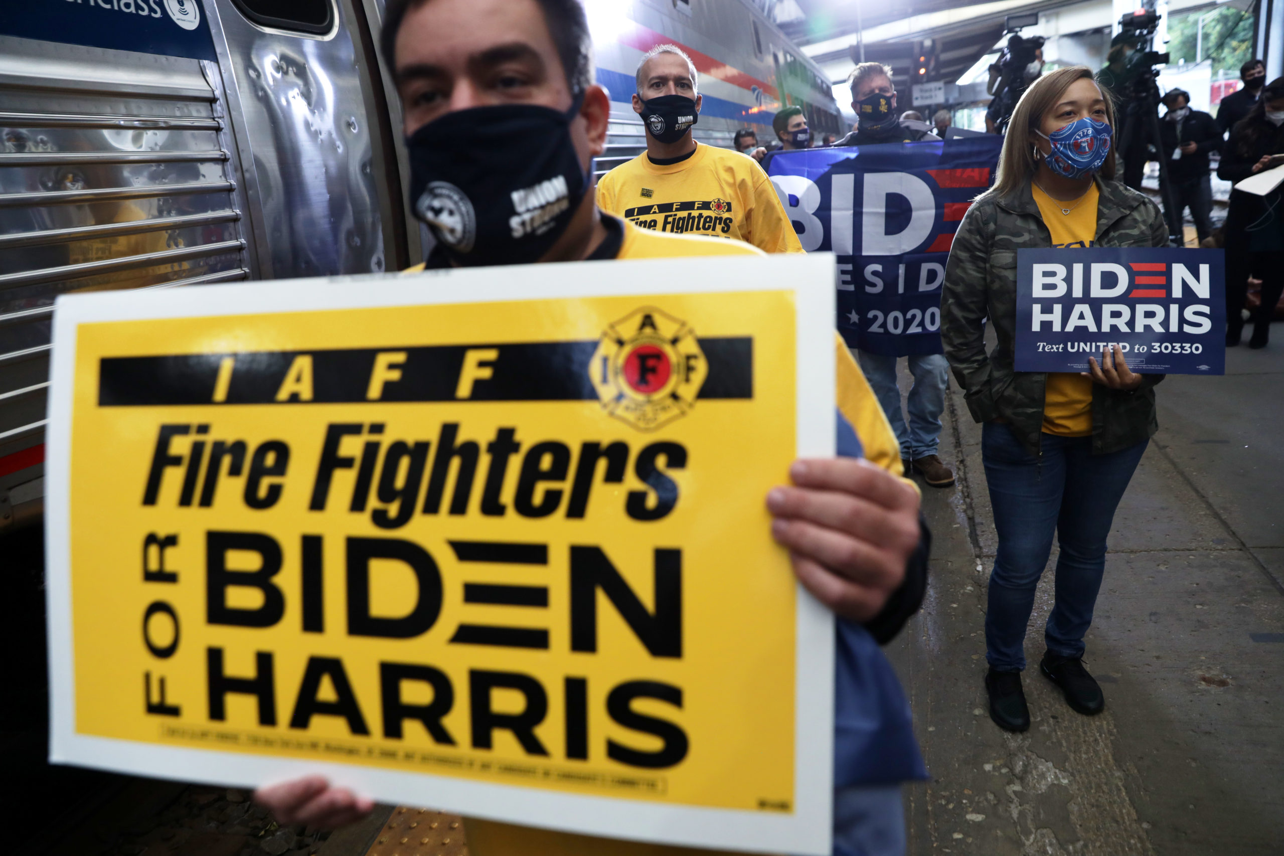 Supporters hold signs during a campaign stop of Pittsburgh Union Station on Sept. 30. (Alex Wong/Getty Images)