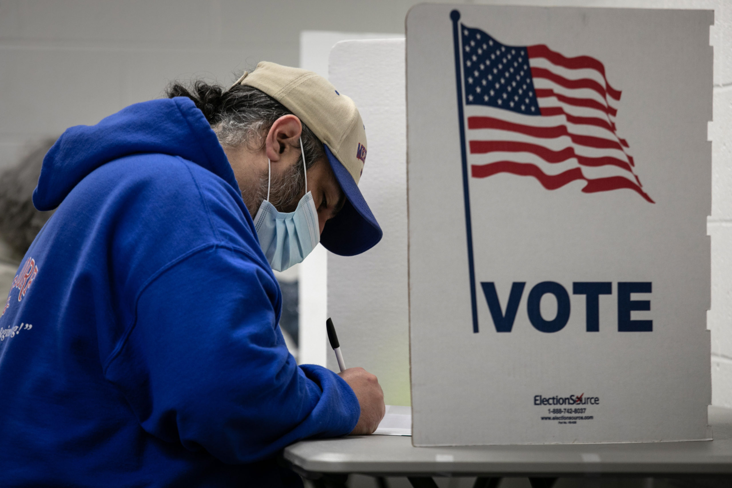 LANSING, MICHIGAN - NOVEMBER 02: A voter fills out his ballot on the last day of early voting at the Lansing City Clerk's office on November 02, 2020 in Lansing, Michigan. In 2016 U.S. President Donald Trump narrowly won Michigan, which is now a main battleground state. (John Moore/Getty Images)