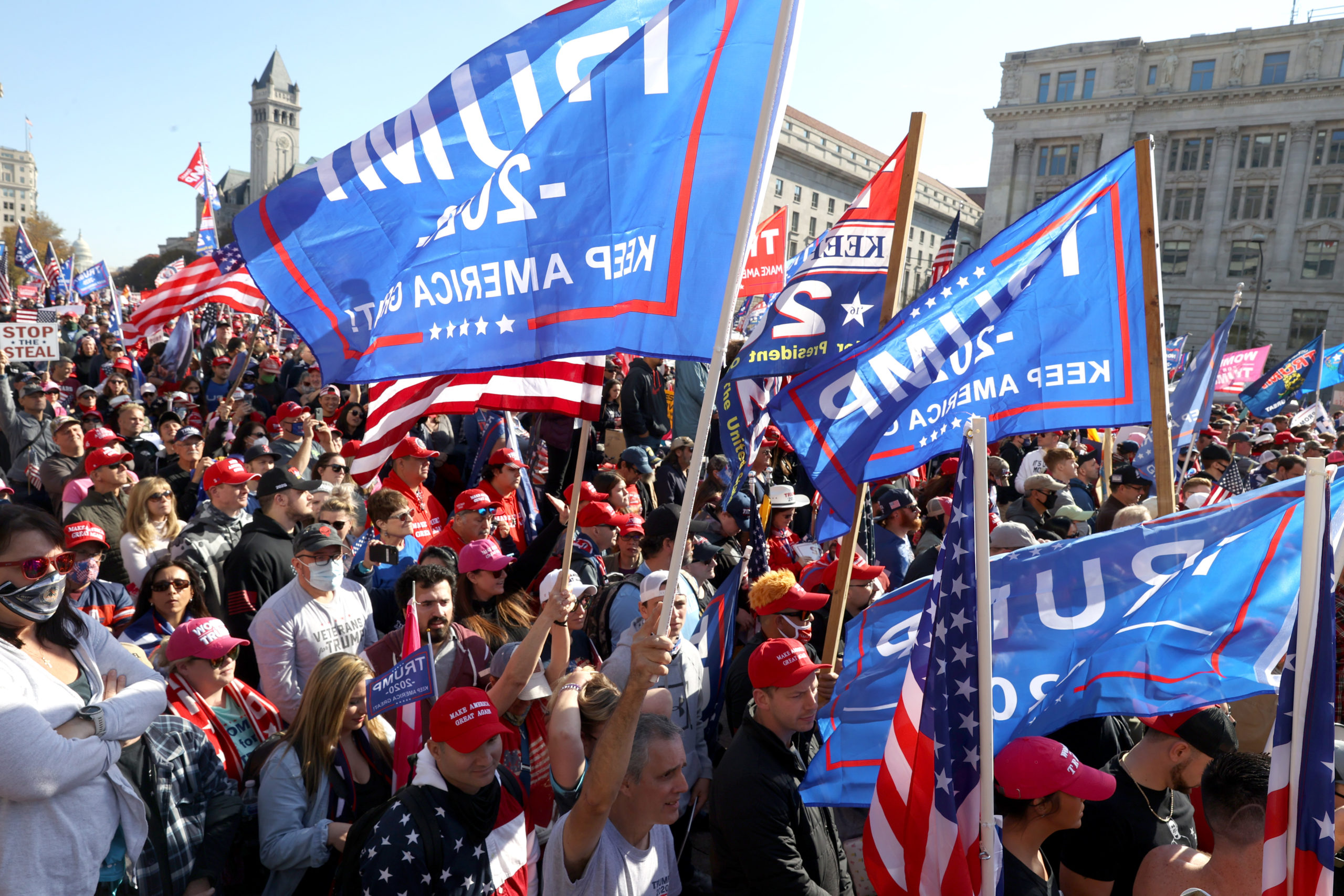 """WASHINGTON, DC - NOVEMBER 14: People participate in the """"Million MAGA March"""" from Freedom Plaza to the Supreme Court, on November 14, 2020 in Washington, DC. Supporters of U.S. President Donald Trump marching to protest the outcome of the 2020 presidential election. (Photo by Tasos Katopodis/Getty Images)"""