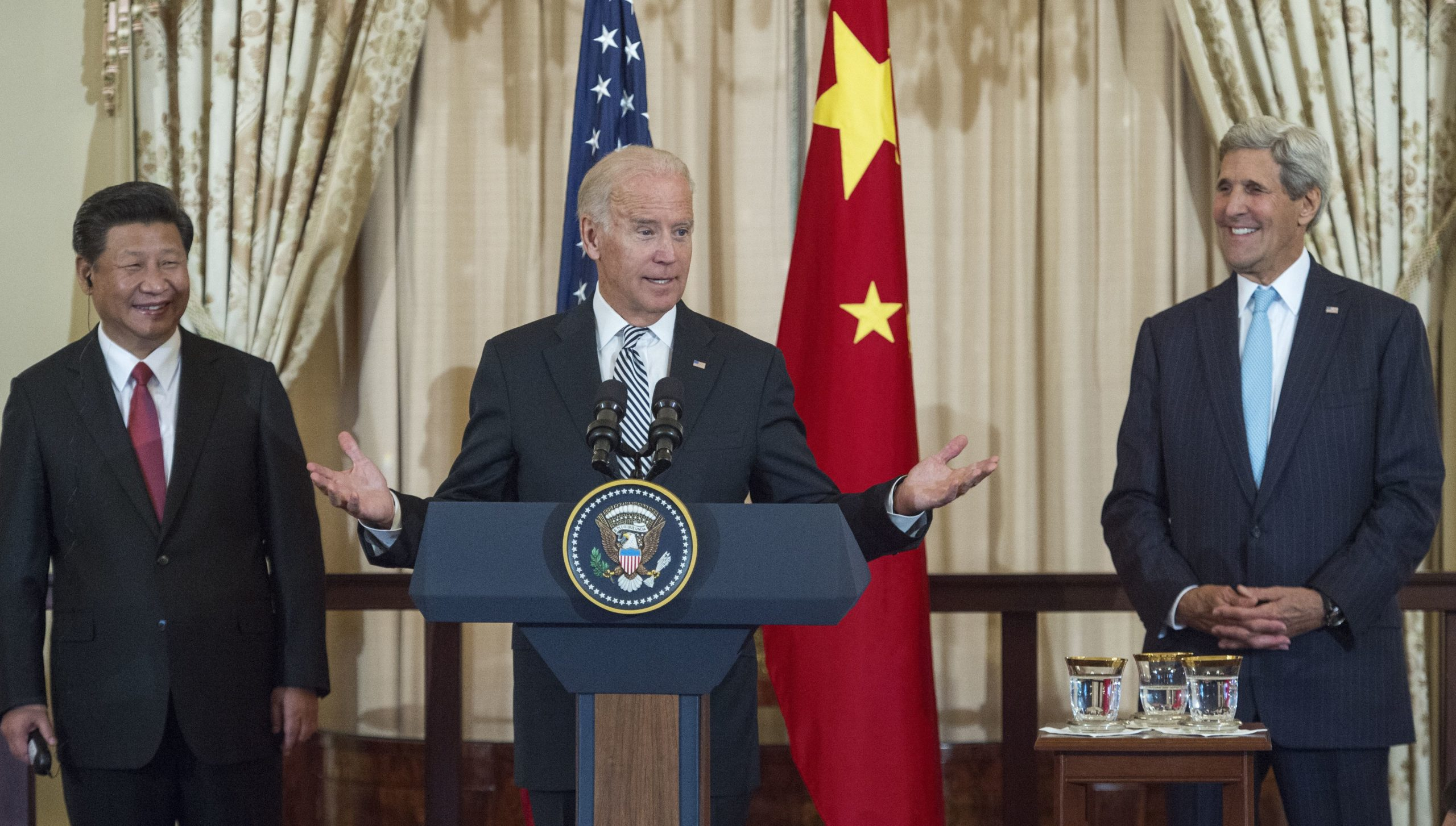 Chinese President Xi Jinping (L) and US Secretary of State John Kerry (R) listens as US Vice President Joe Biden speaks during a State Luncheon for China hosted by Kerry on September 25, 2015 at the Department of State in Washington, DC. (PAUL J. RICHARDS/AFP via Getty Images)