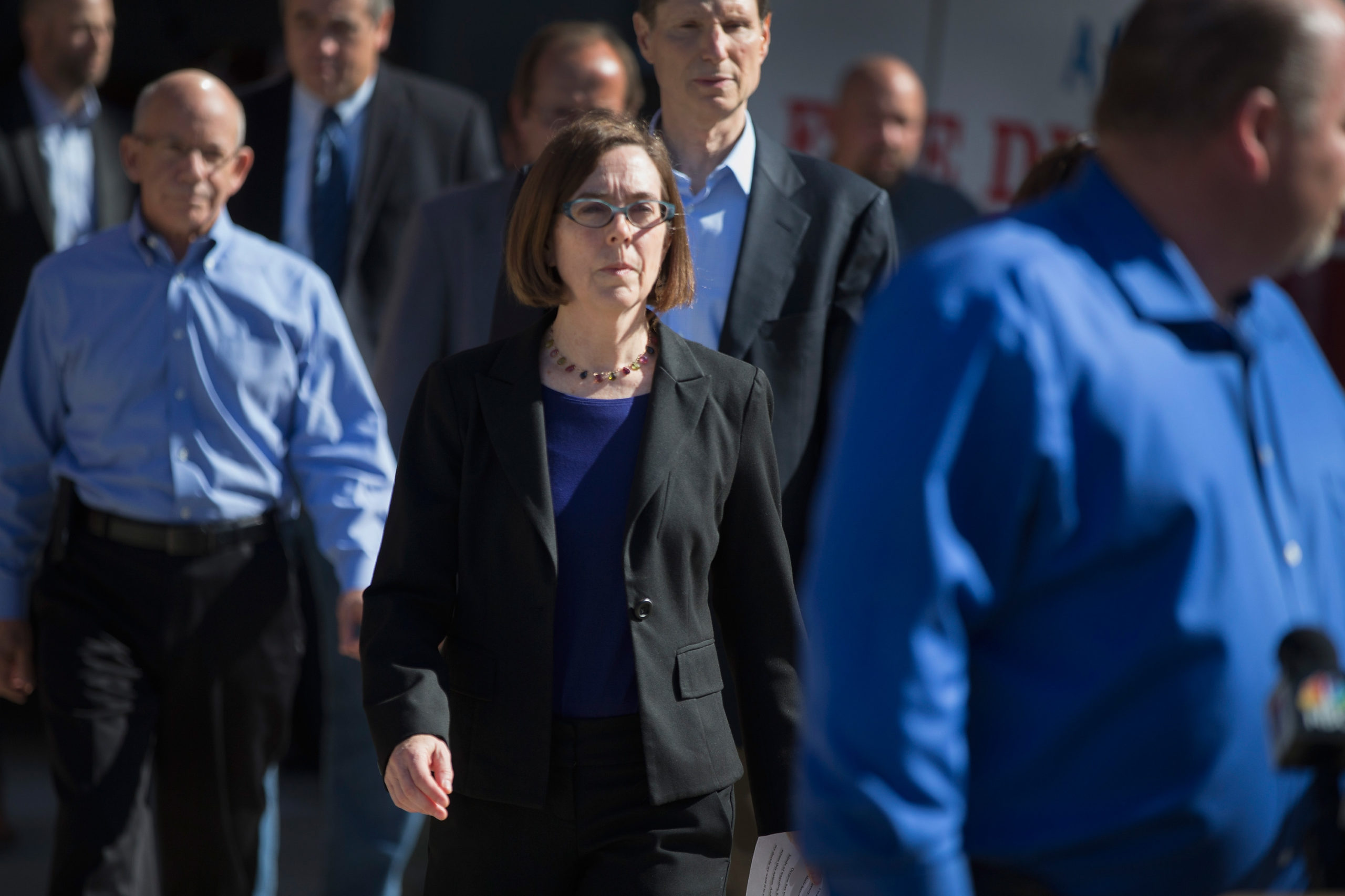 ROSEBURG, OR - OCTOBER 02: Oregon governor Kate Brown (C) arrives for a press conference where she addressed the mass shooting at Umpqua Community College on October 2, 2015 in Roseburg, Oregon. Yesterday 26-year-old Chris Harper Mercer went on a shooting rampage at the campus, killing 9 people and wounding another seven before he was killed. (Scott Olson/Getty Images)