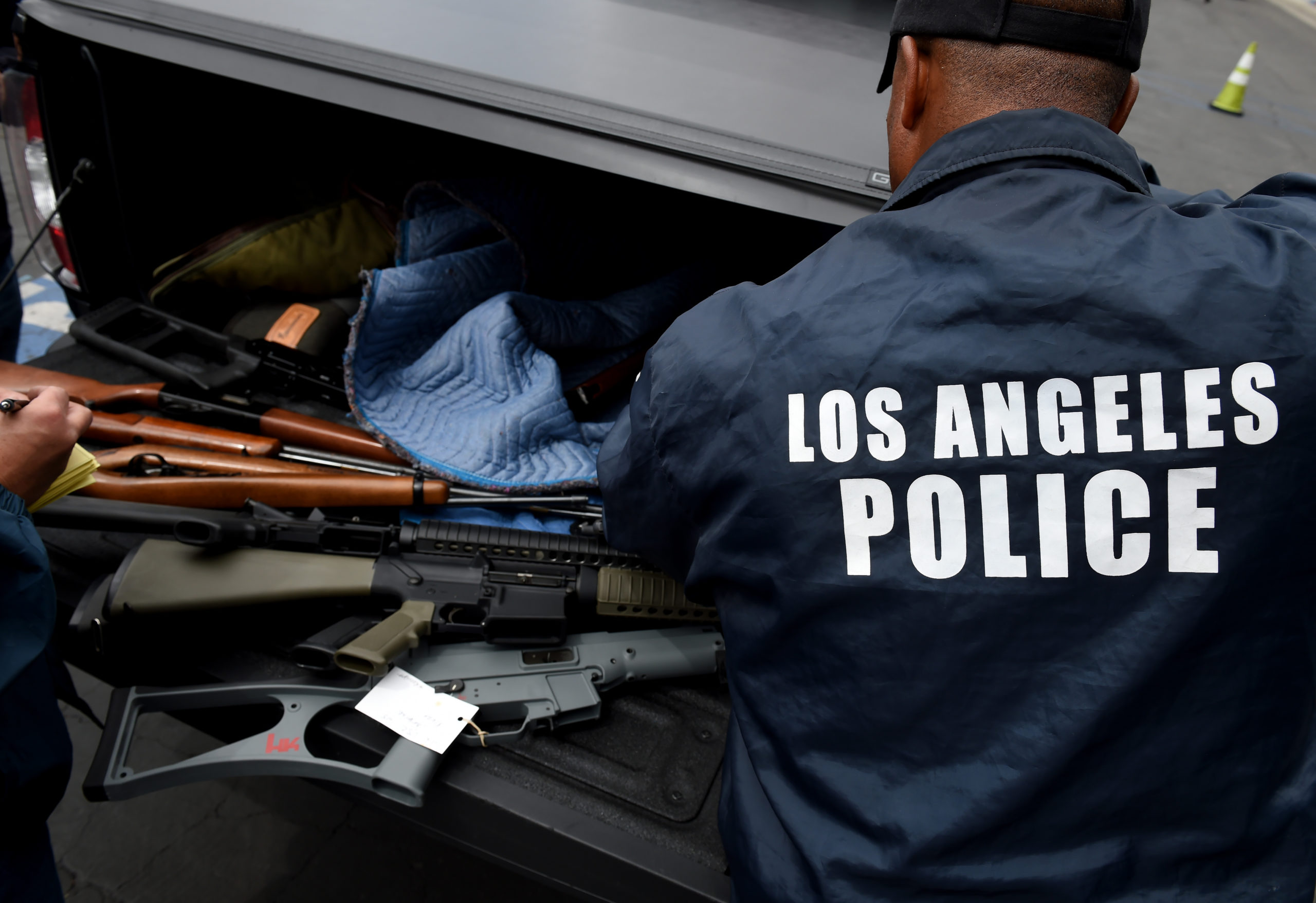 Rifles and assault rifles among a batch of thirteen that were exchanged for gift cards are seen during a Los Angeles Police Department and Mayor's Office of Gang Reduction and Youth Development sponsored gun buyback event in Los Angeles, California on May 7, 2016. The city held the event in two locations and the public were able to safely and anonymously surrender firearms in exchange for $100 and $200 gift cards. / AFP PHOTO / Mark Ralston (Photo credit should read MARK RALSTON/AFP via Getty Images)