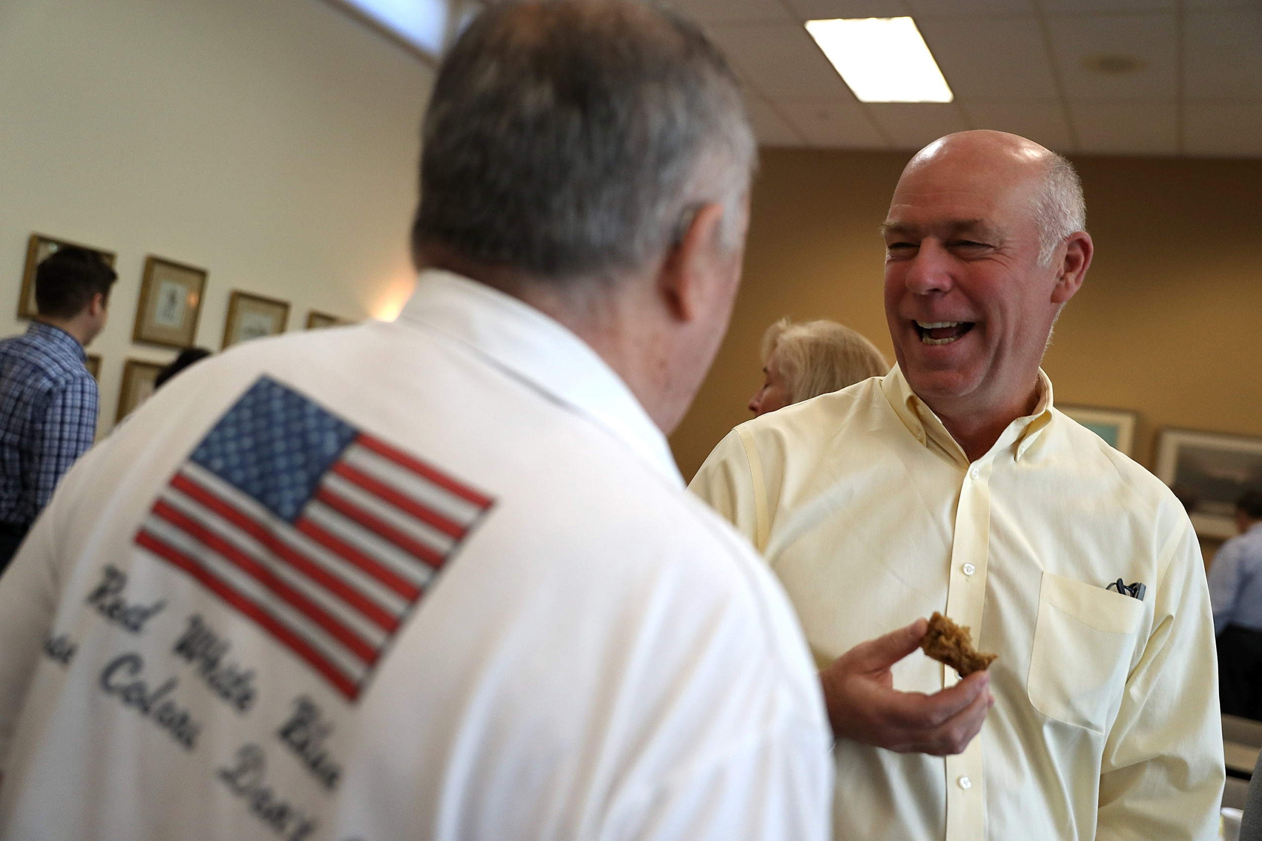 Republican Rep. Greg Gianforte talks with a supporter during a campaign meet and greet in 2017 in Missoula, Montana. (Justin Sullivan/Getty Images)