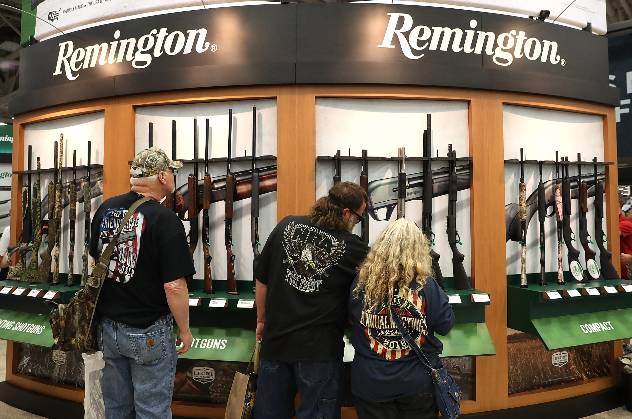 DALLAS, TX - MAY 05: Attendees look at a display of Remington shotguns during the NRA Annual Meeting & Exhibits at the Kay Bailey Hutchison Convention Center on May 5, 2018 in Dallas, Texas. The National Rifle Association's annual meeting and exhibit runs through Sunday. (Justin Sullivan/Getty Images)