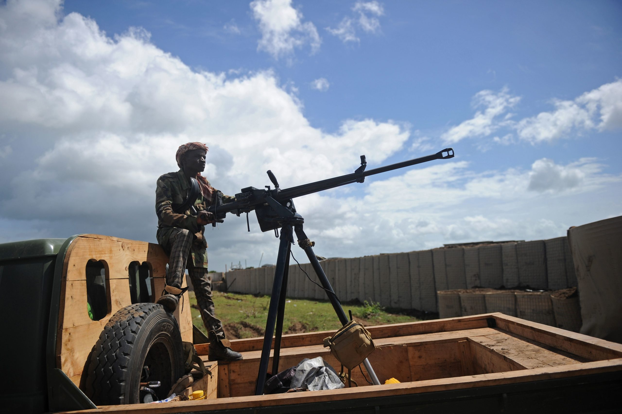 A Somali soldier holds a machine gun at Sanguuni military base, where an American special operations soldier was killed by a mortar attack on June 8, about 450 km south of Mogadishu, Somalia, on June 13, 2018. - More than 500 American forces are partnering with African Union Mission to Somalia (AMISOM) and Somali national security forces in counterterrorism operations, and have conducted frequent raids and drone strikes on Al-Shabaab training camps throughout Somalia. (MOHAMED ABDIWAHAB/AFP via Getty Images)