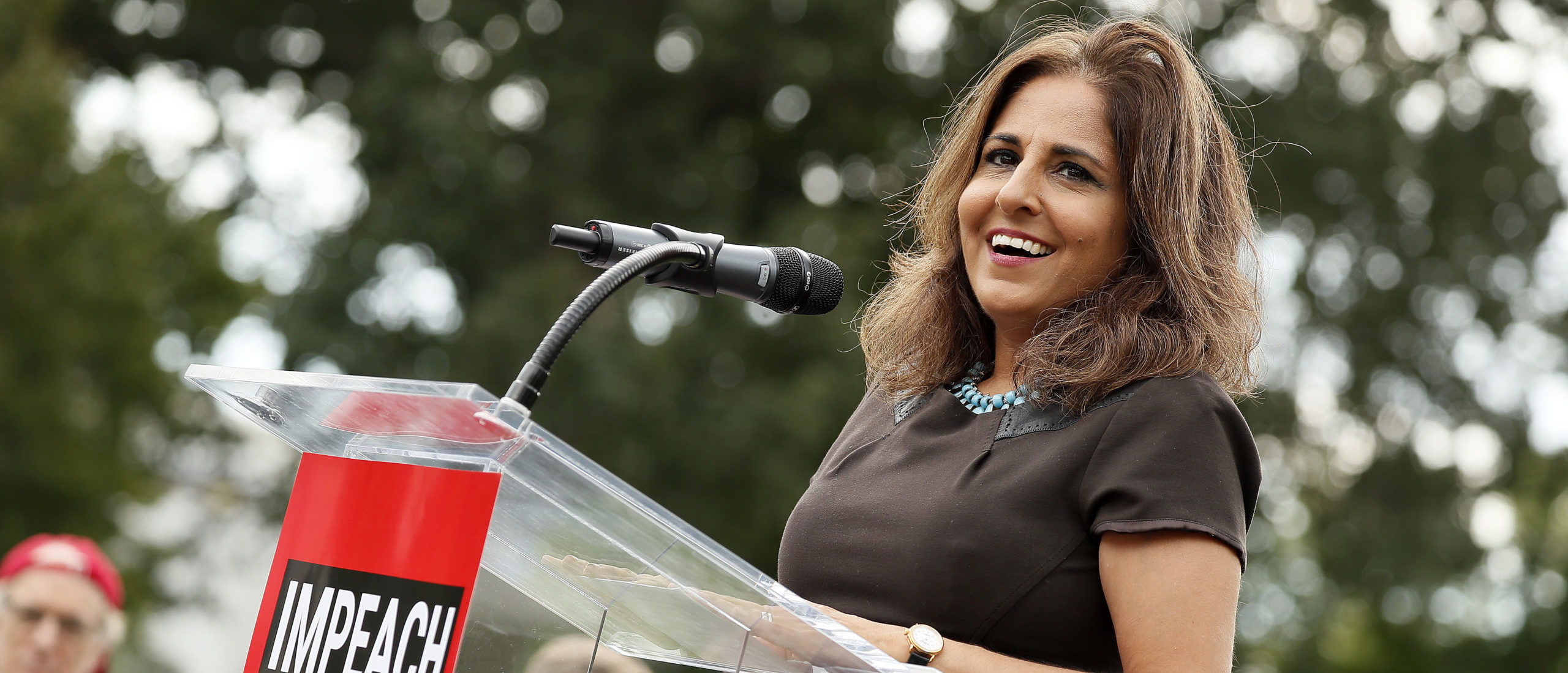 """WASHINGTON, DC - SEPTEMBER 26: Neera Tanden, president, Center for American Progress, speaks at the """"Impeachment Now!"""" rally in support of an immediate inquiry towards articles of impeachment against U.S. President Donald Trump on the grounds of the U.S. Capital on September 26, 2019in Washington, DC. (Photo by Paul Morigi/Getty Images for MoveOn Political Action)"""