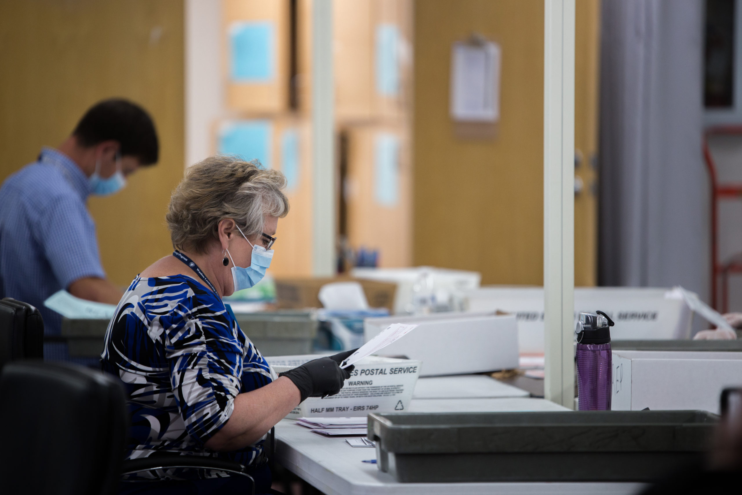 Poll Workers During 2020 Election (not representative of poll workers in news story) - Trevor Bexon - Shutterstock