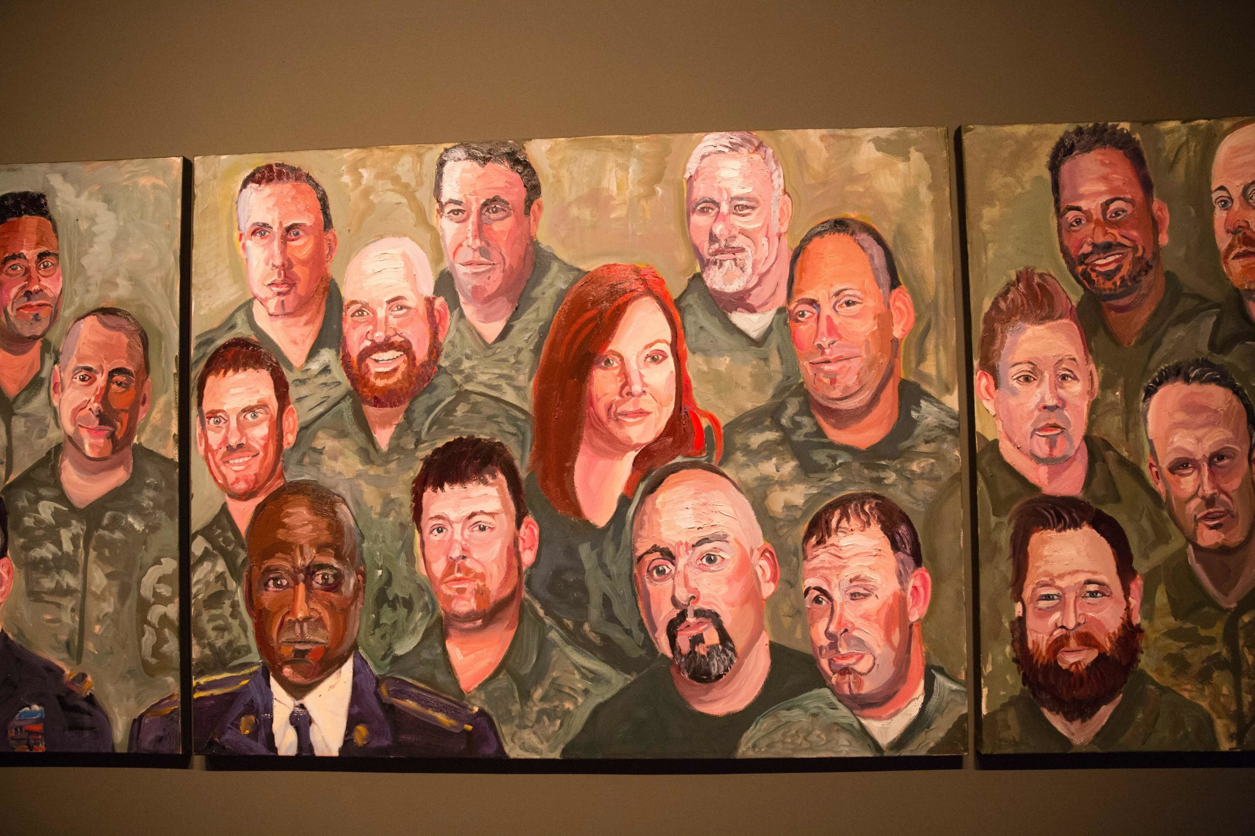 """Paintings of wounded US military veterans painted by former US President George W. Bush hang in """"Portraits of Courage"""", a new exhibit at the George W. Bush Presidential Library and Museum in Dallas, Texas, on February 28, 2017. (Photo by LAURA BUCKMAN/AFP via Getty Images)"""