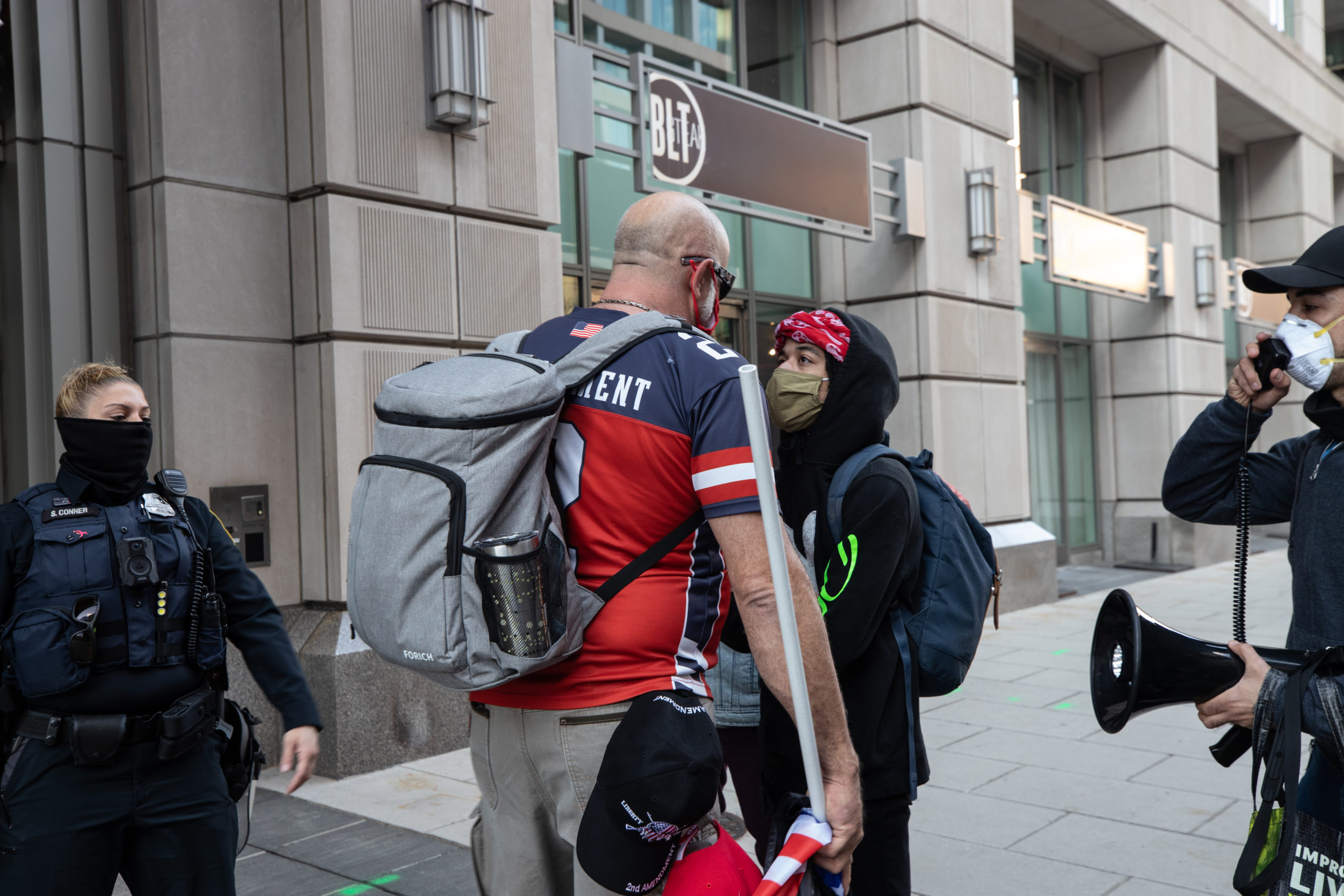 A supporter of President Donald Trump confronted a counter protester in Black Lives Matter Plaza on Dec. 12, 2020. (Photo: Kaylee Greenlee - Daily Caller News Foundation)