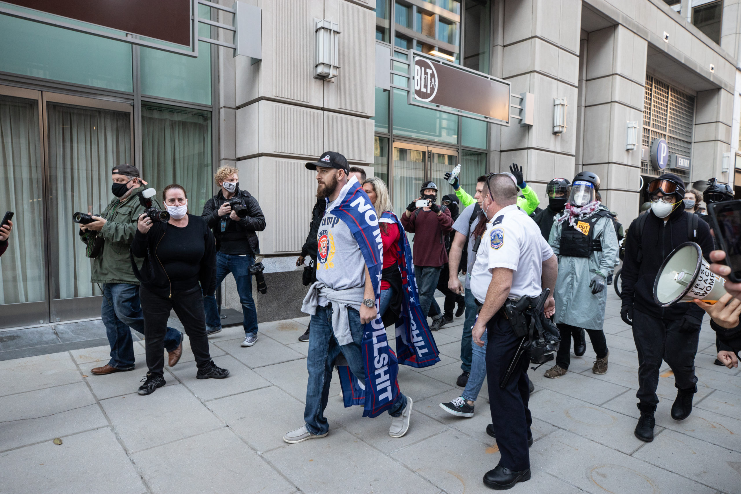 A supporter of President Donald Trump was escorted away from counter protesters by Metropolitan Police Department officers in Black Lives Matter Plaza in Washington, D.C. on Dec. 12, 2020. (Photo: Kaylee Greenlee - Daily Caller News Foundation)
