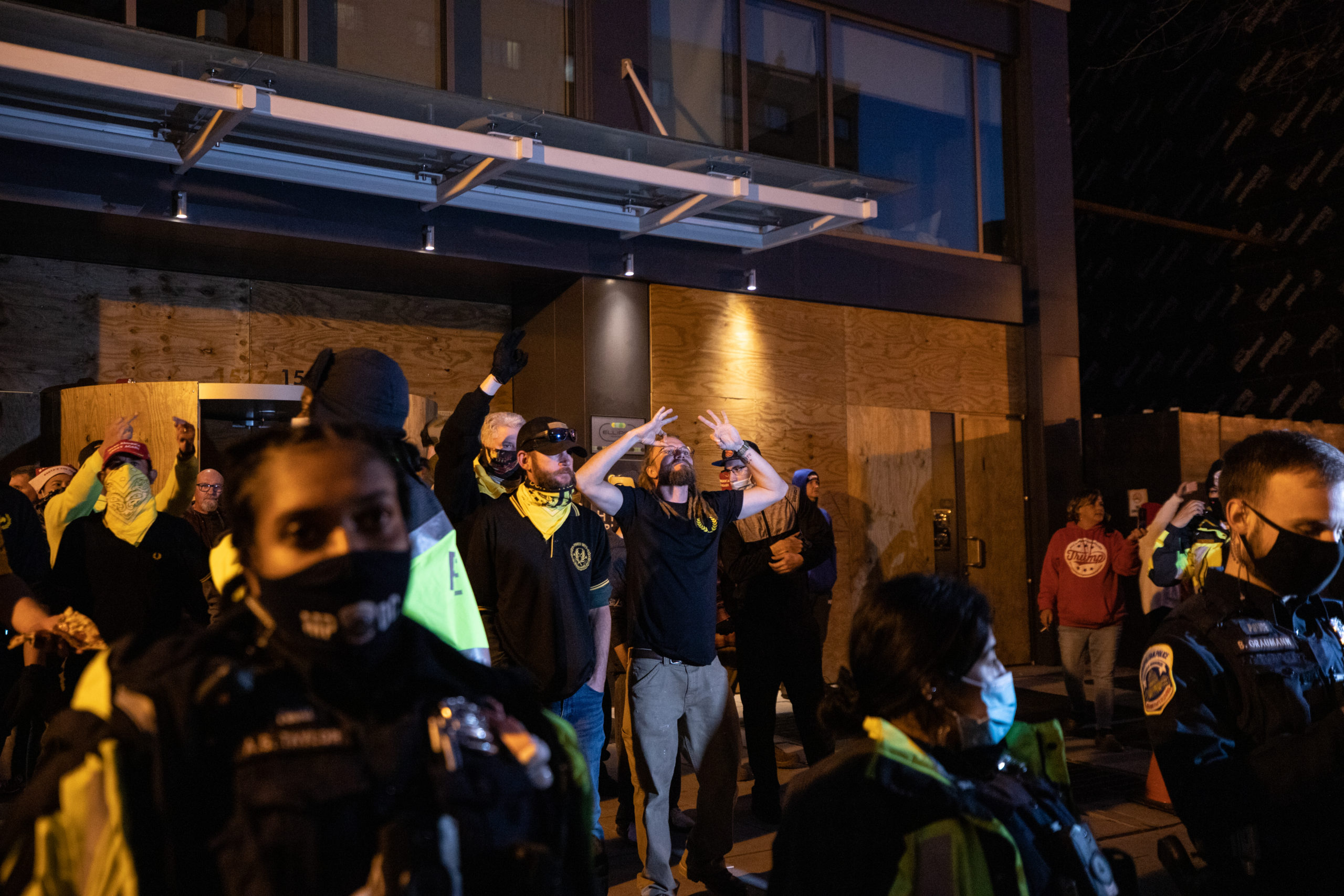 Members of the Proud Boys flashed the white power signs at counter protesters near Black Lives Matter Plaza in Washington, D.C. on Dec. 12, 2020. (Photo: Kaylee Greenlee - Daily Caller News Foundation)