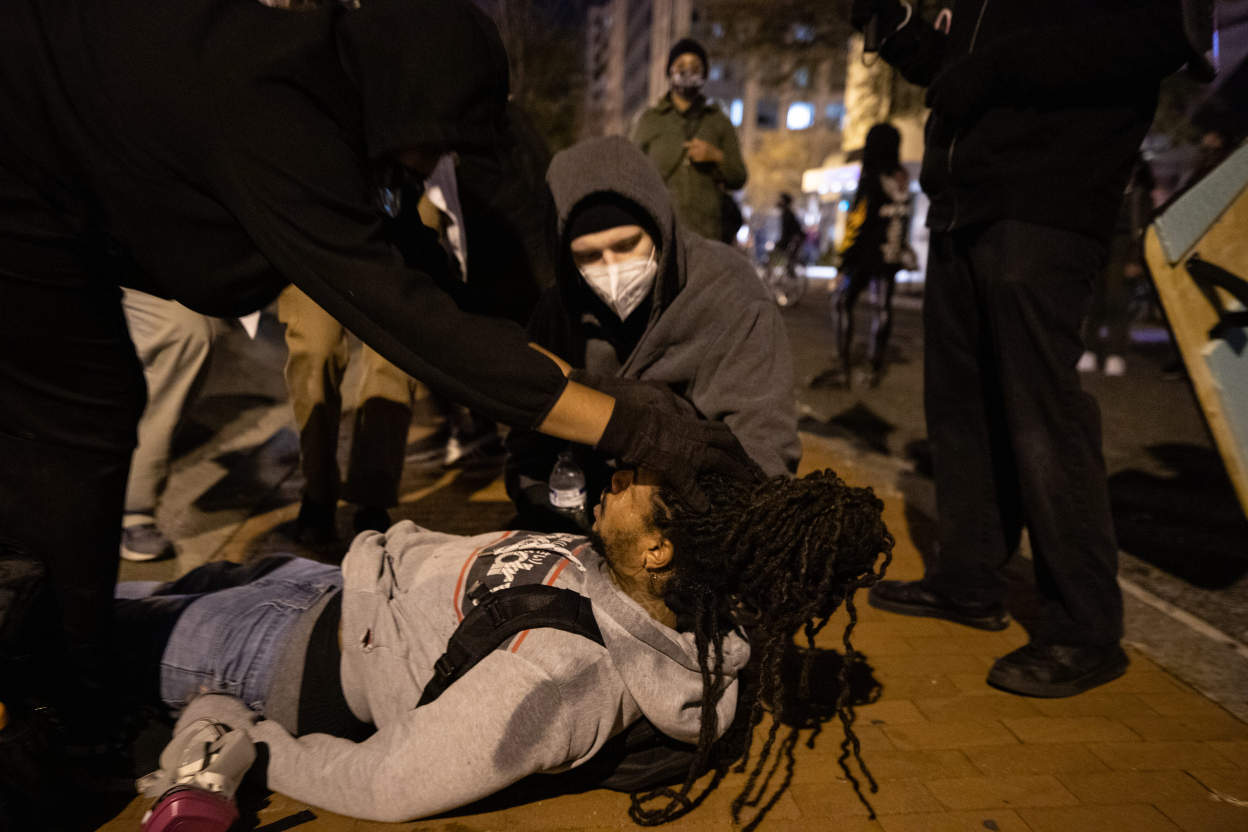 Protesters attend to a man who was maced by Metropolitan Police Department officers near Black Lives Matter Plaza in Washington, D.C. on Dec. 12, 2020. (Photo: Kaylee Greenlee - Daily Caller News Foundation)