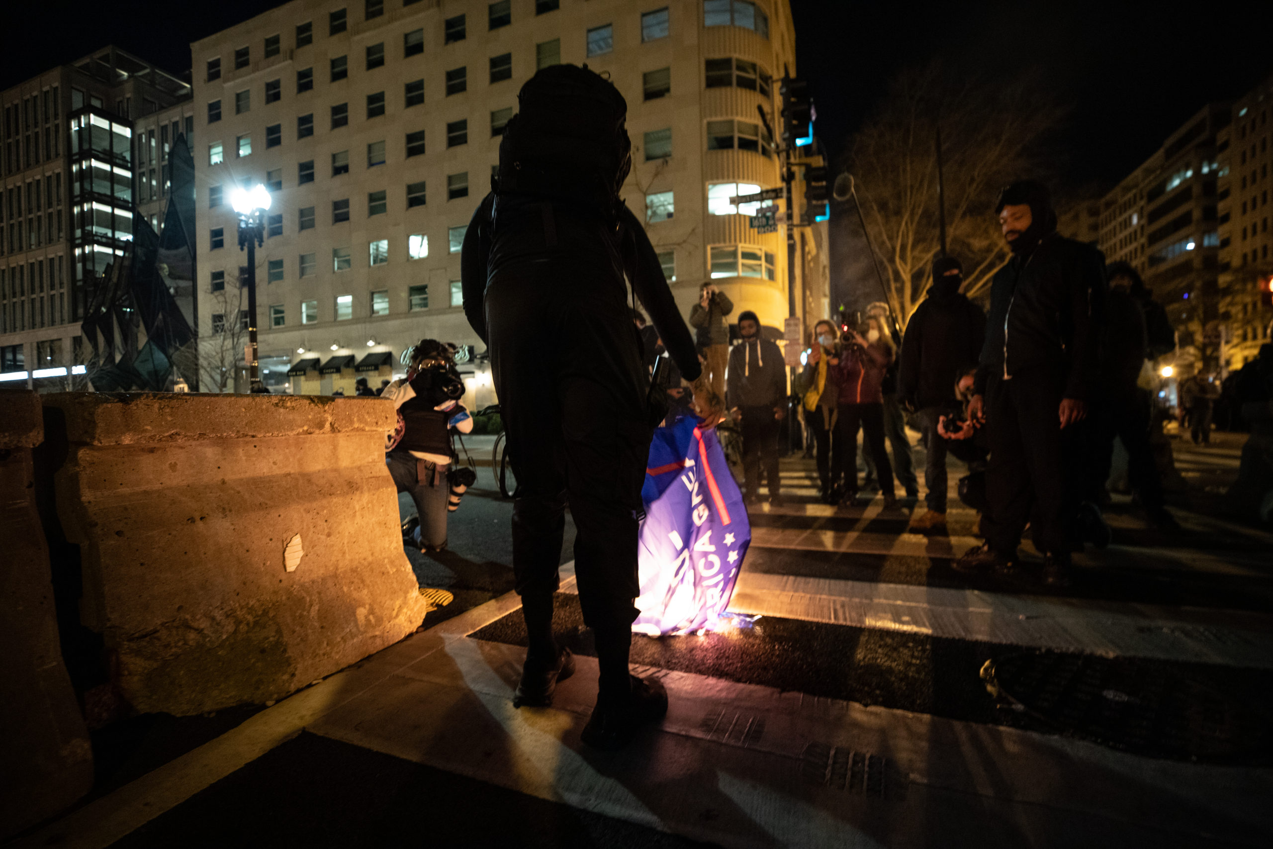 A protester burns a MAGA flag during a counter protest against a pro-President Donald Trump demonstration in Black Lives Matter Plaza in Washington, D.C. on Dec. 12, 2020(Photo: Kaylee Greenlee - Daily Caller News Foundation)