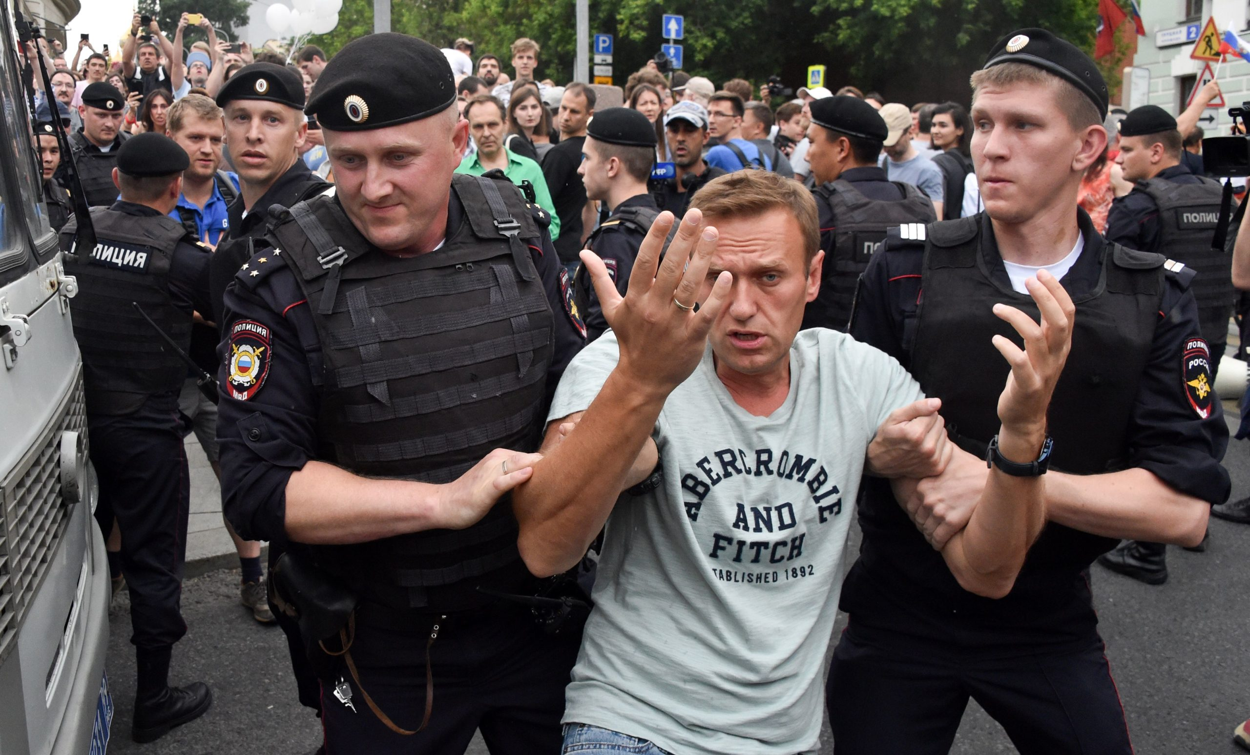 Opposition leader Alexei Navalny is detained by Russian police officers during a march to protest against the alleged impunity of law enforcement agencies in central Moscow in 2019. (Vasily Maximov/AFP via Getty Images)